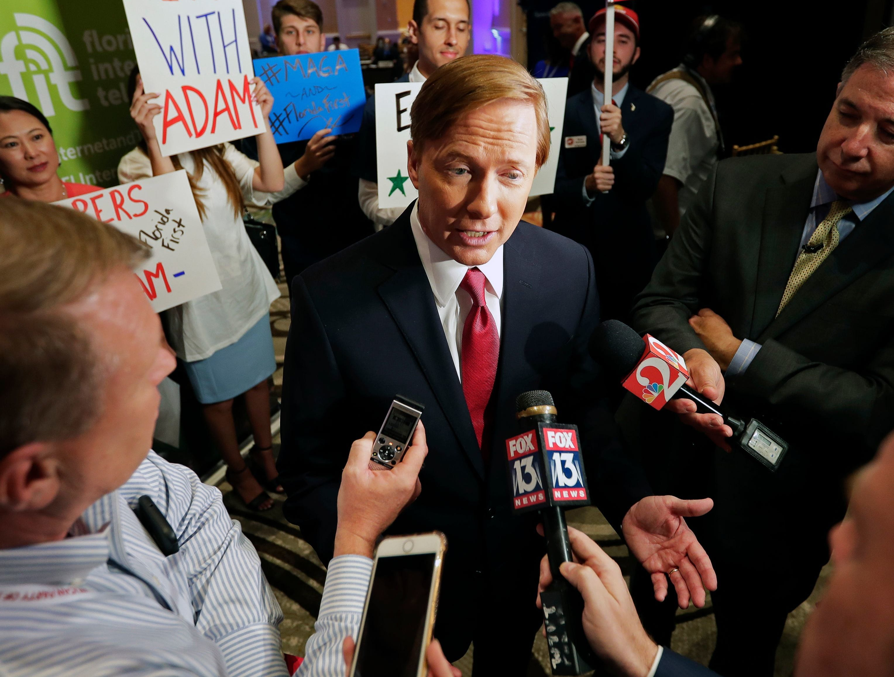 June 28, 2018 - Agriculture Commissioner Adam Putnam, center, meets with members of the media after a  Republican gubernatorial primary debate at the Republican Sunshine Summit in Kissimmee.