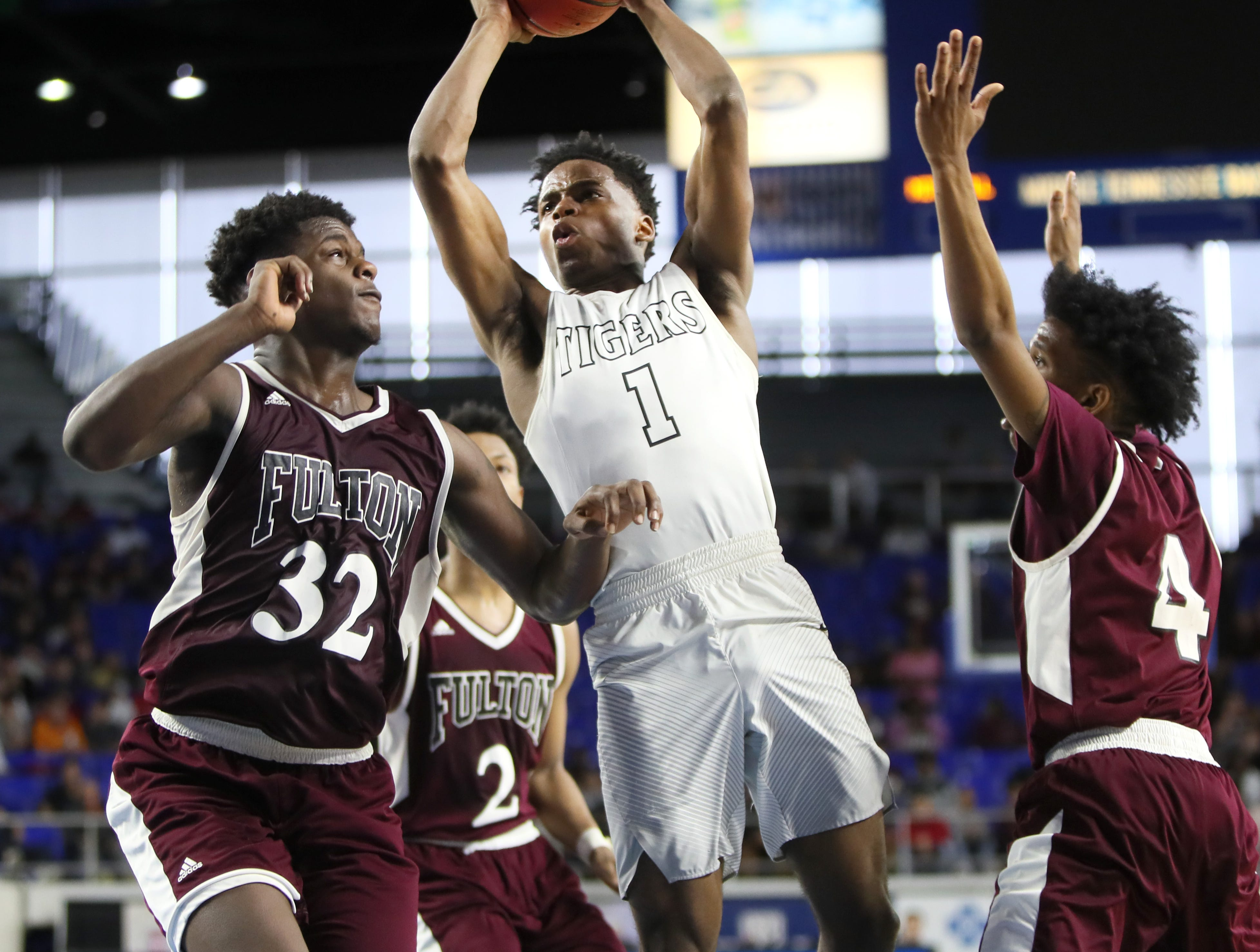 Mitchell's Mikell Rice shoots the ball over Fulton's Deshaun Page, left, and Edward Lacy during the TSSAA Division I basketball state tournament in Murfreesboro on Wednesday, March 13, 2019.