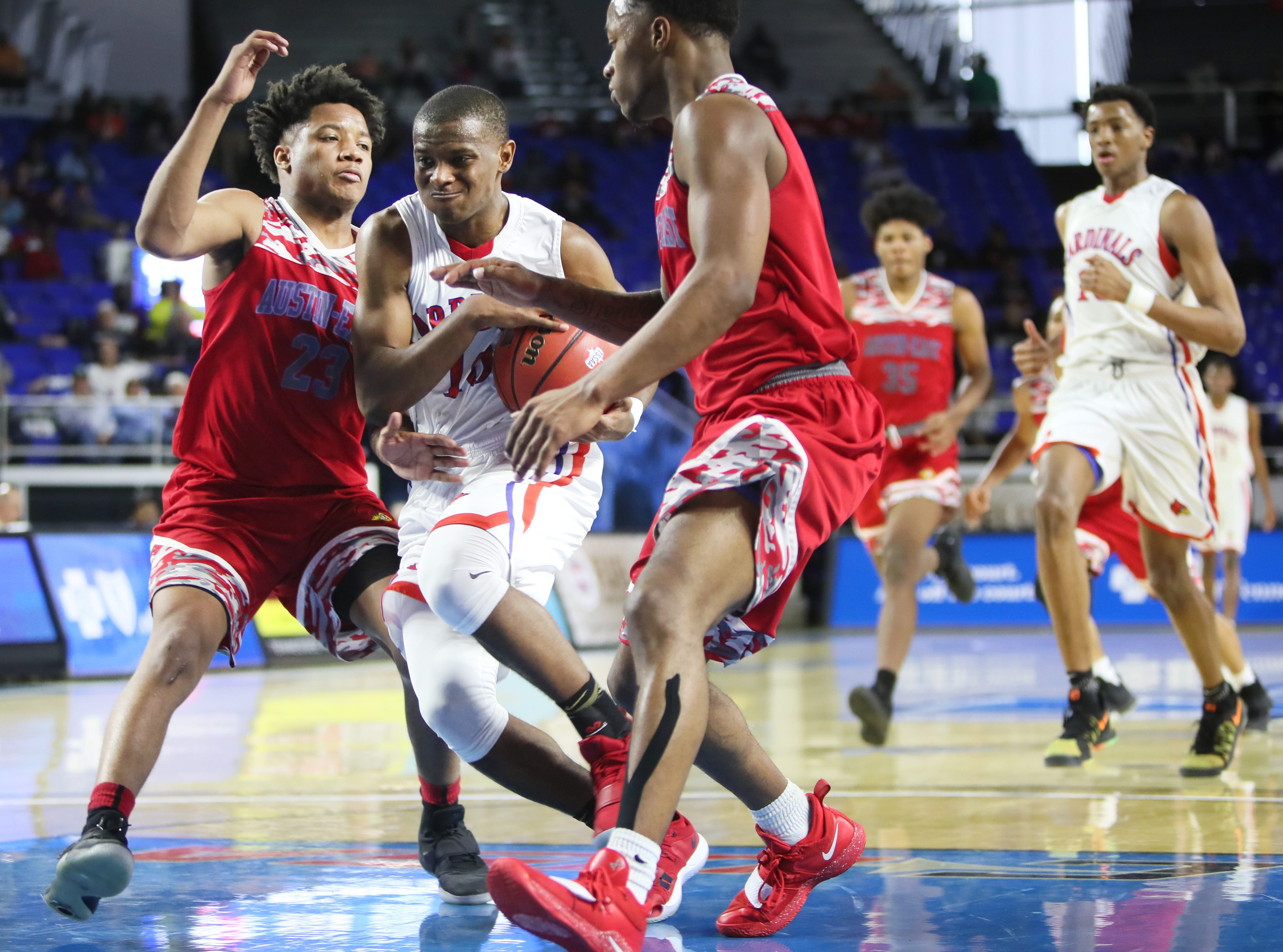 Wooddale's Jonathan Duncan drives betweeen Austin-East's Laron Dixon, left, and Ronney Pierson during the TSSAA Division I basketball state tournament in Murfreesboro on Wednesday, March 13, 2019.