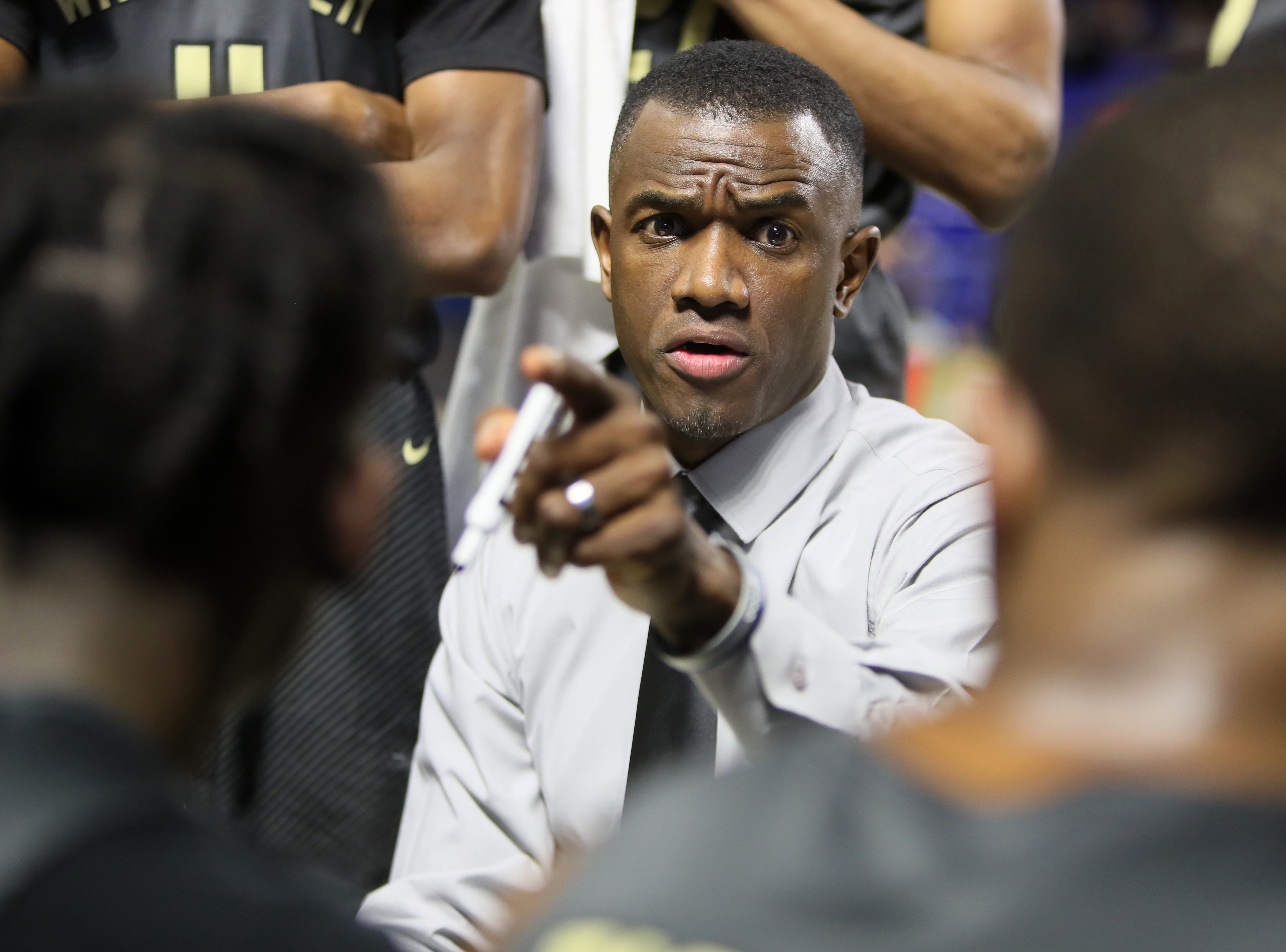 Whitehaven Head Coach Faragi Phillips talks to his team during a timeout in their game against Sevier County during the TSSAA Division I basketball state tournament at the Murphy Center in Murfreesboro, Tenn. on Wednesday, March 13, 2019.