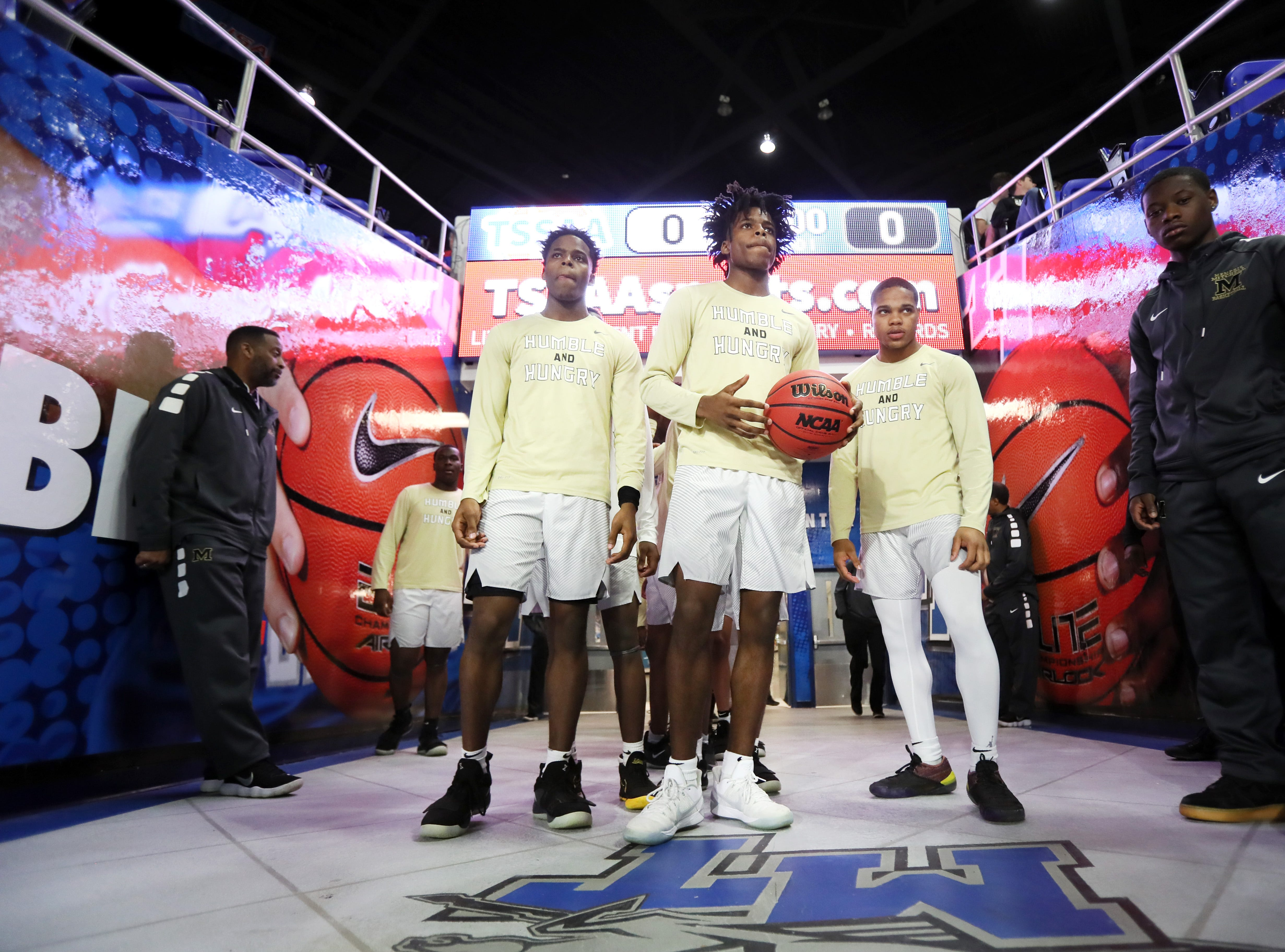 Mitchell players prepare to take the court for their game against Fulton during their TSSAA Division I basketball state tournament in Murfreesboro on Wednesday, March 13, 2019.