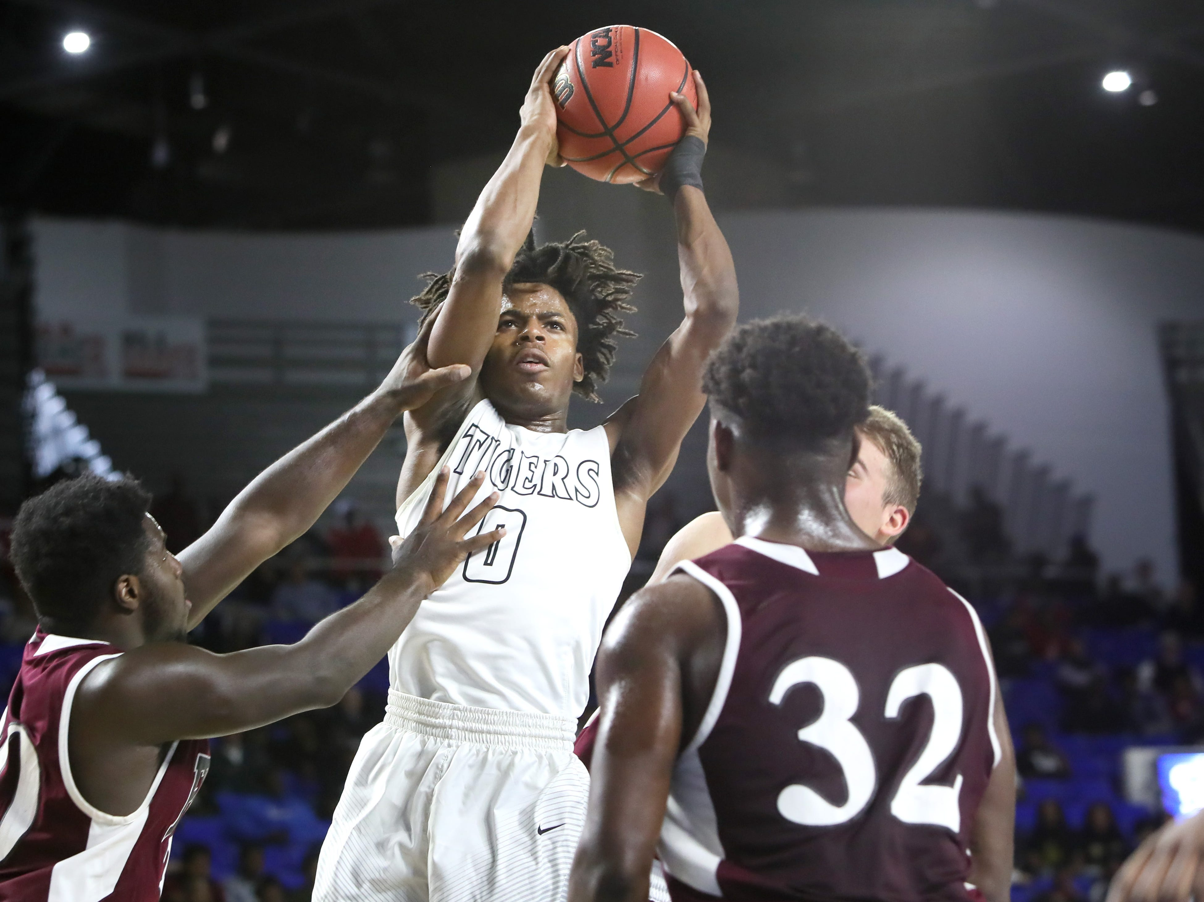 Mitchell's Michael Rice shoots the ball over Fulton's Jashaun Fenderson during the TSSAA Division I basketball state tournament in Murfreesboro on Wednesday, March 13, 2019.