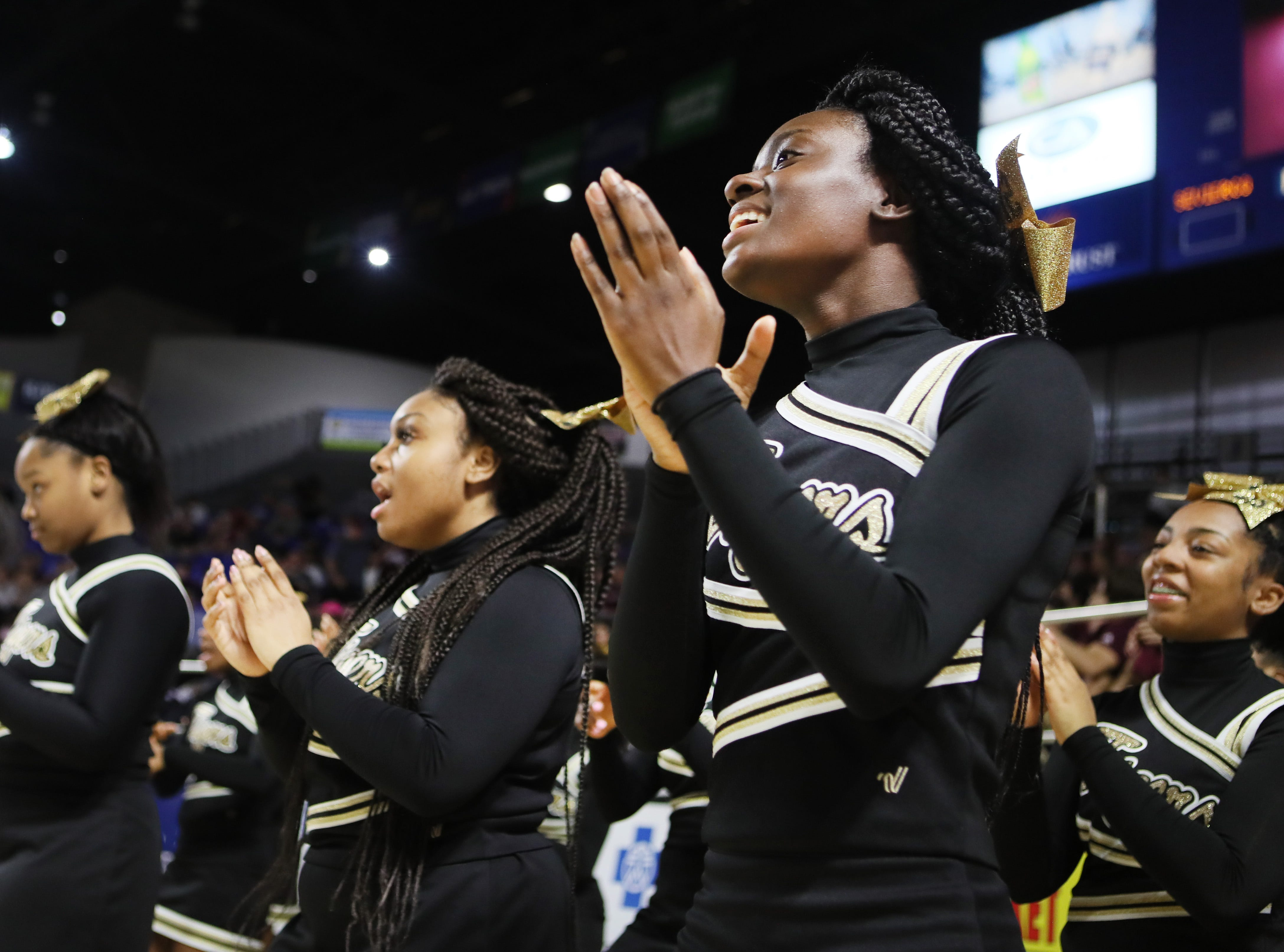 Whitehaven's cheerleaders perform as their team takes on Sevier County during the TSSAA Division I basketball state tournament at the Murphy Center in Murfreesboro, Tenn. on Wednesday, March 13, 2019.
