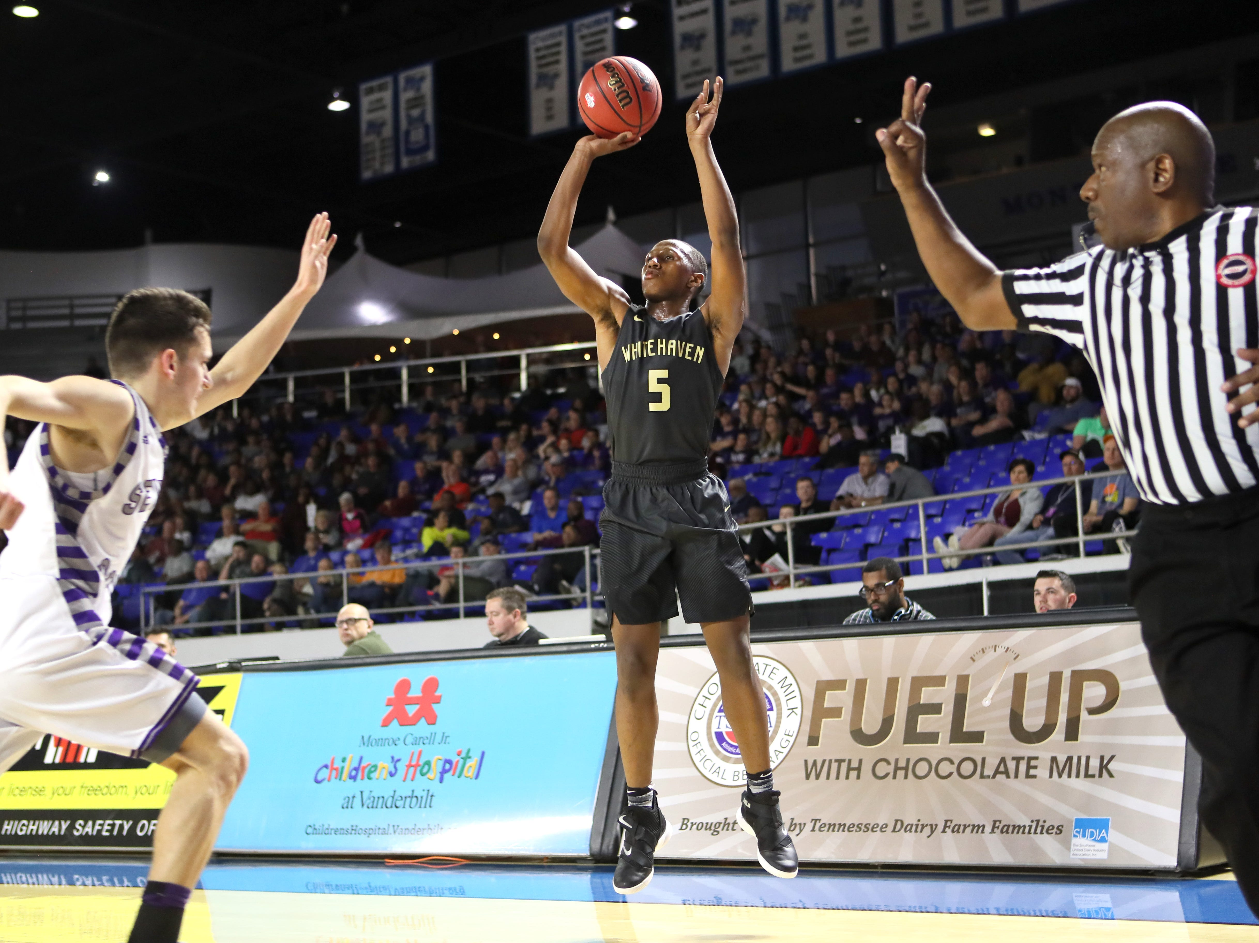 Whitehaven's Ladricus Pittman shoots a 3-pointer against Sevier County during the TSSAA Division I basketball state tournament at the Murphy Center in Murfreesboro, Tenn. on Wednesday, March 13, 2019.