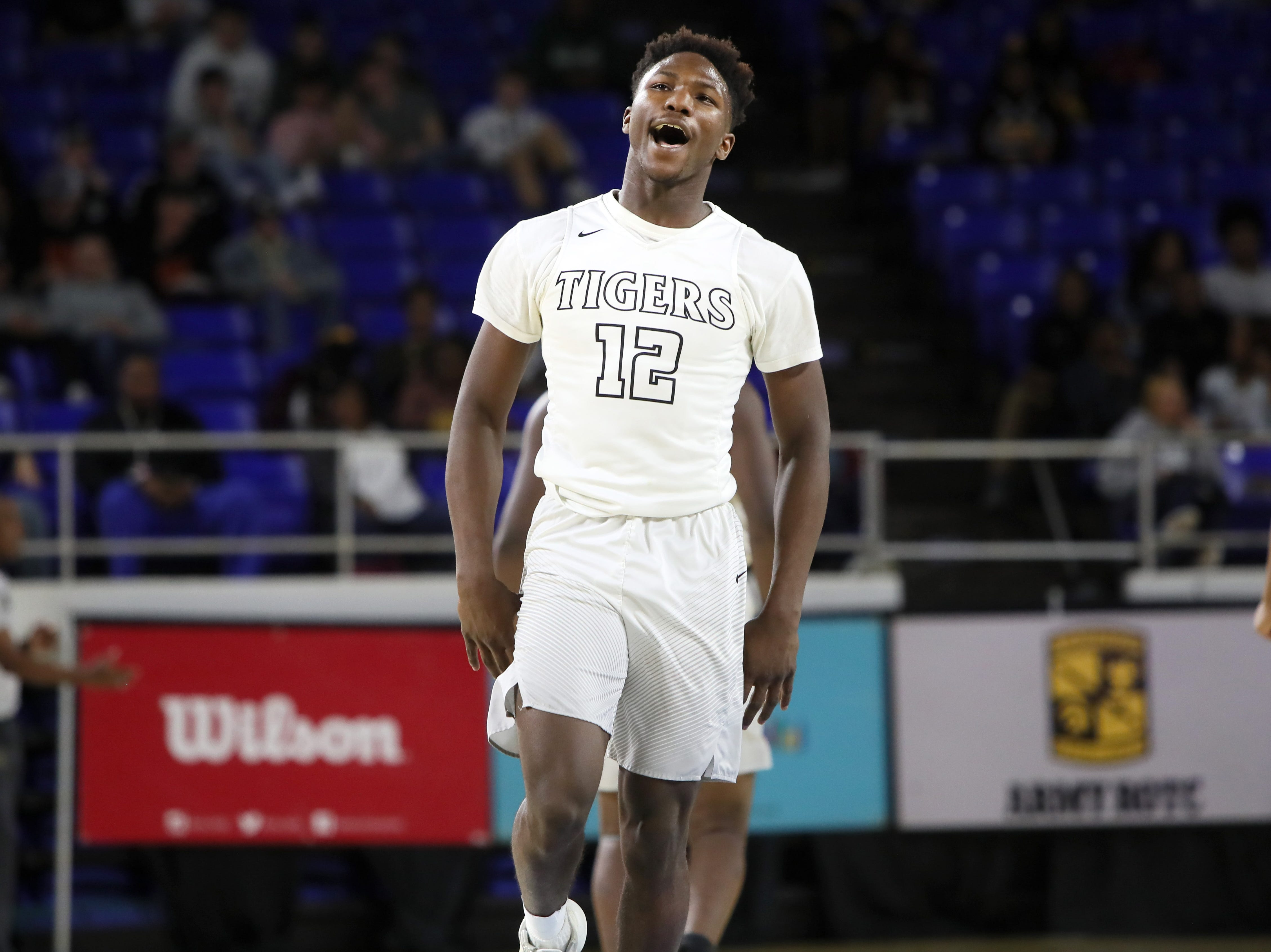 Mitchell's Phabian Dale celebrates a defensive stop against Fulton during their TSSAA Division I basketball state tournament in Murfreesboro on Wednesday, March 13, 2019.
