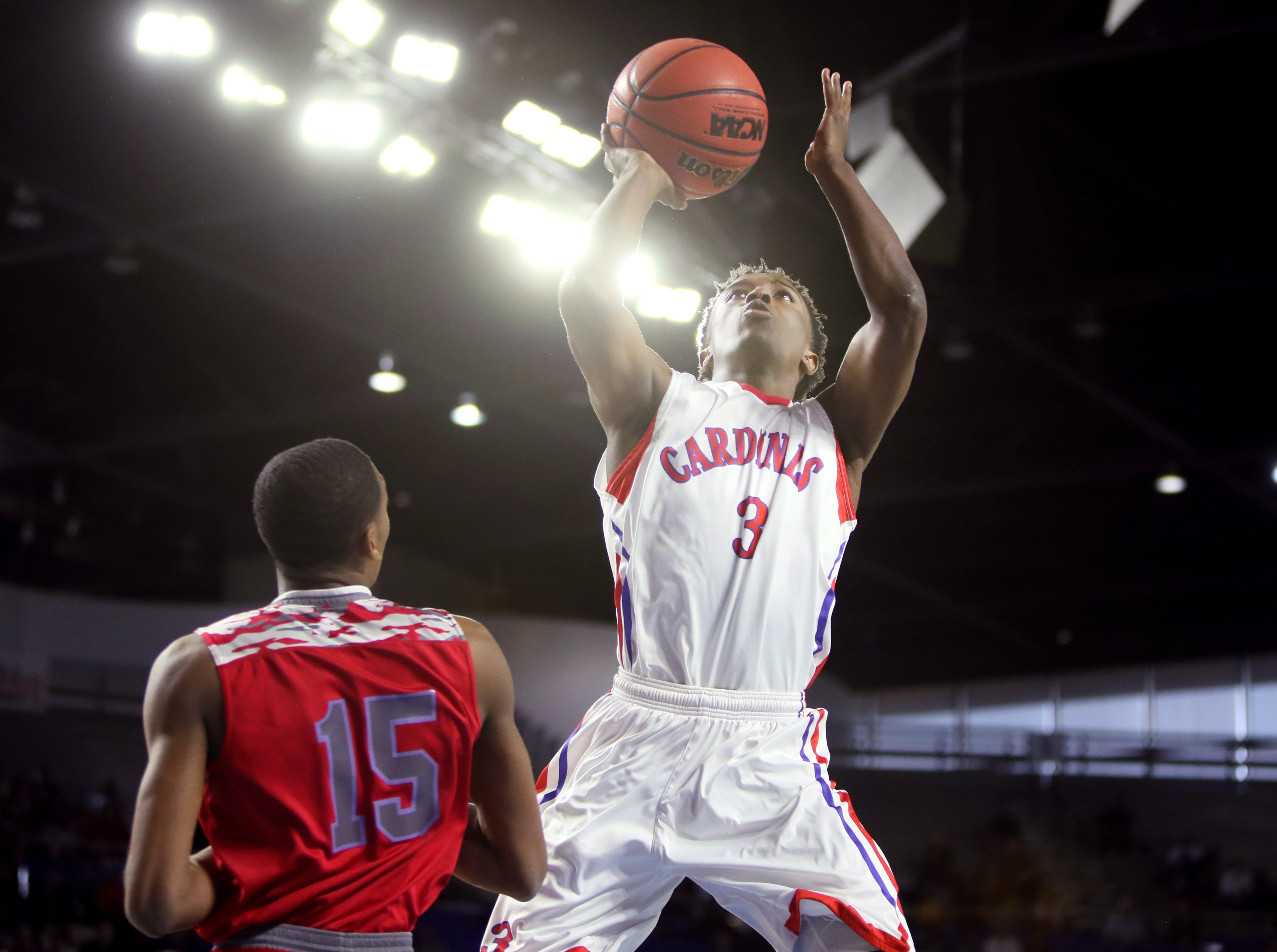Wooddale's Alvin Miles shoots the ball over Austin-East's Kajuan Bullard during the TSSAA Division I basketball state tournament in Murfreesboro on Wednesday, March 13, 2019.