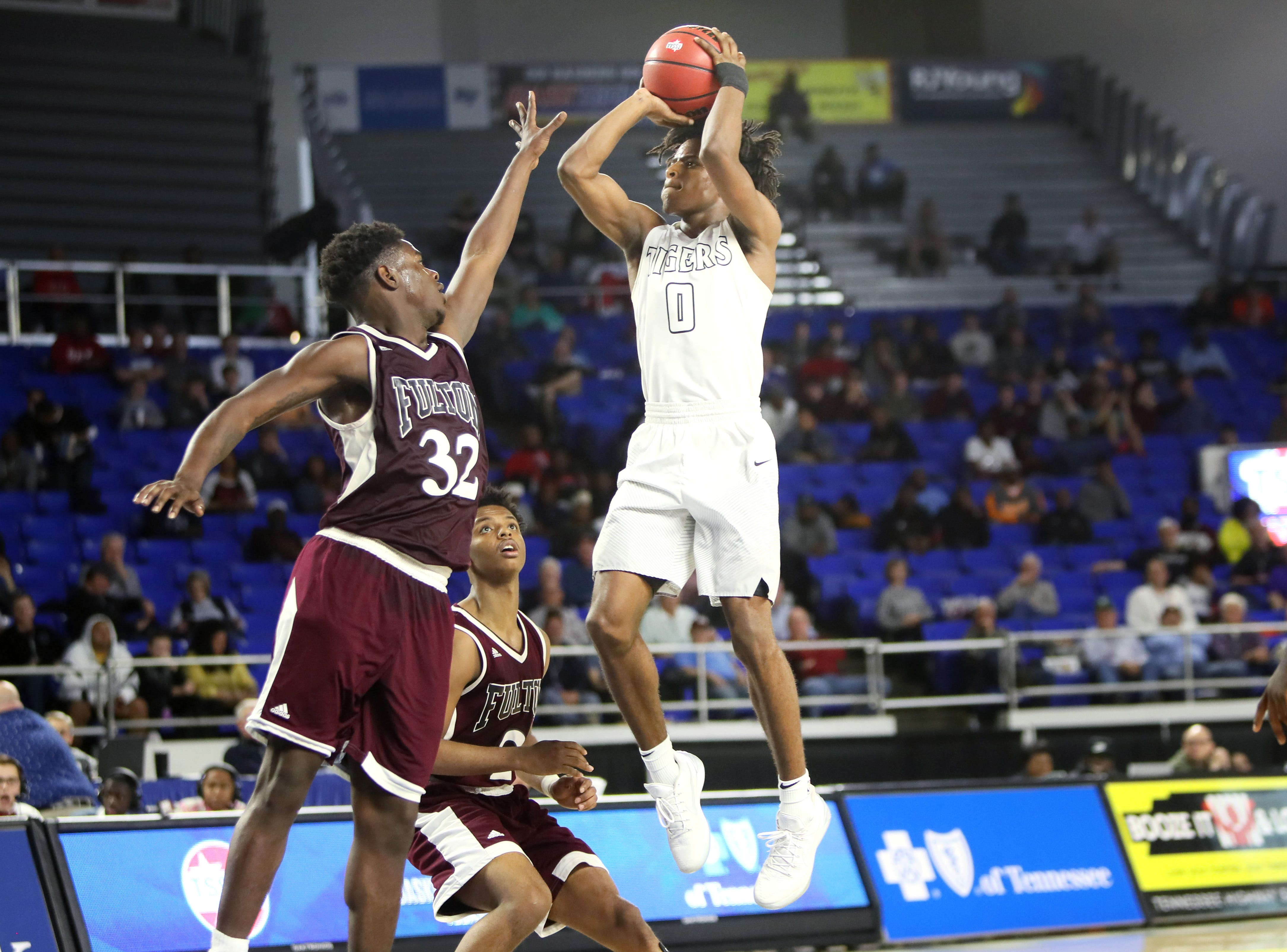 Mitchell's Michael Rice shoots the ball over Fulton's Deshaun Page during the TSSAA Division I basketball state tournament in Murfreesboro on Wednesday, March 13, 2019.