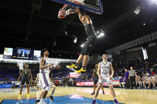 Whitehaven's Matthew Murrell dunks the ball on a lob pass against Sevier County during the TSSAA Division I basketball state tournament at the Murphy Center in Murfreesboro, Tenn. on Wednesday, March 13, 2019.