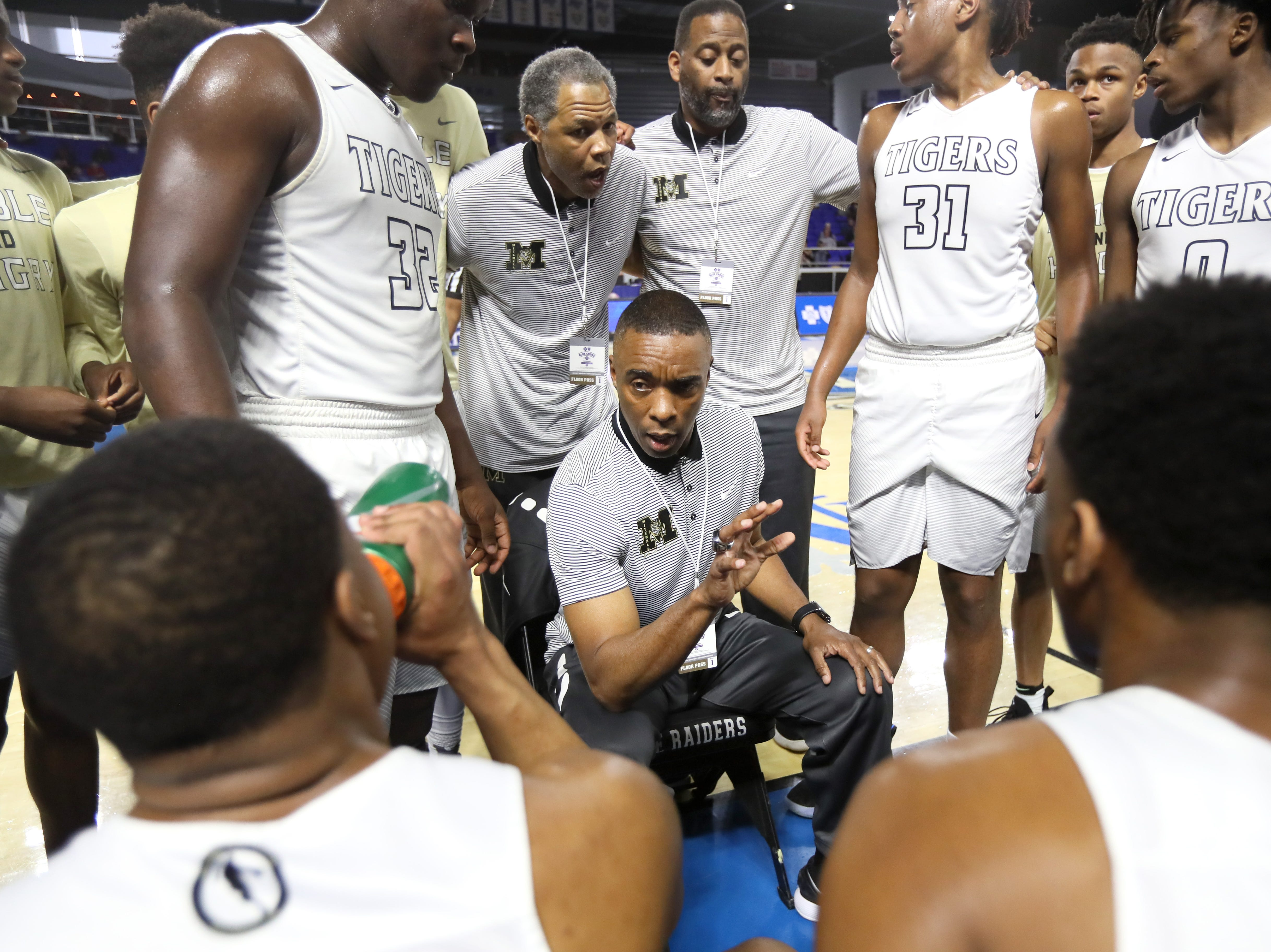 Mitchell Head Coach Andre Turner talks to his team during a timeout in their game against Fulton during the TSSAA Division I basketball state tournament in Murfreesboro on Wednesday, March 13, 2019.