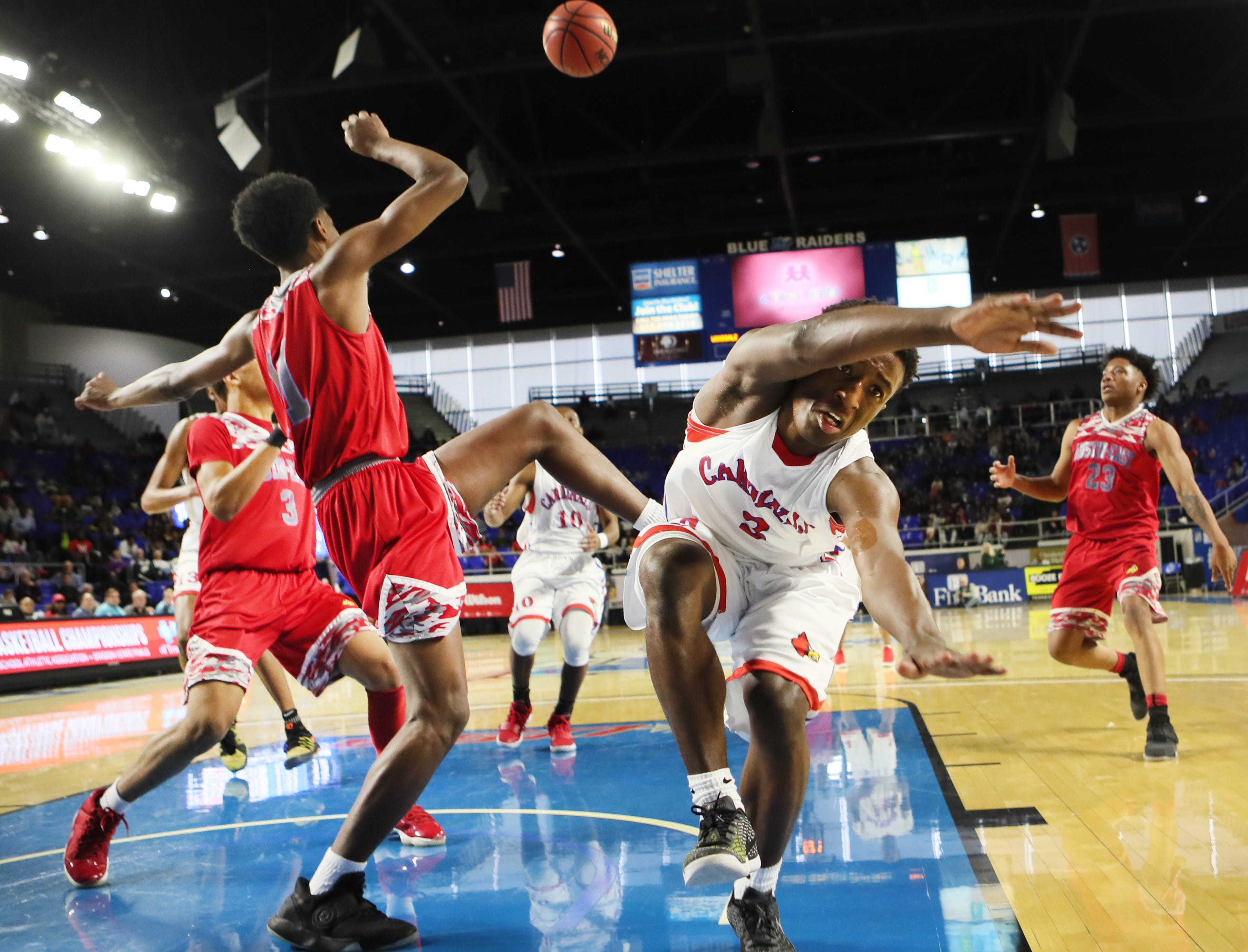 Wooddale's Alvin Miles loses control of the ball after being fouled by Austin-East's Joshua Harris during the TSSAA Division I basketball state tournament in Murfreesboro on Wednesday, March 13, 2019.