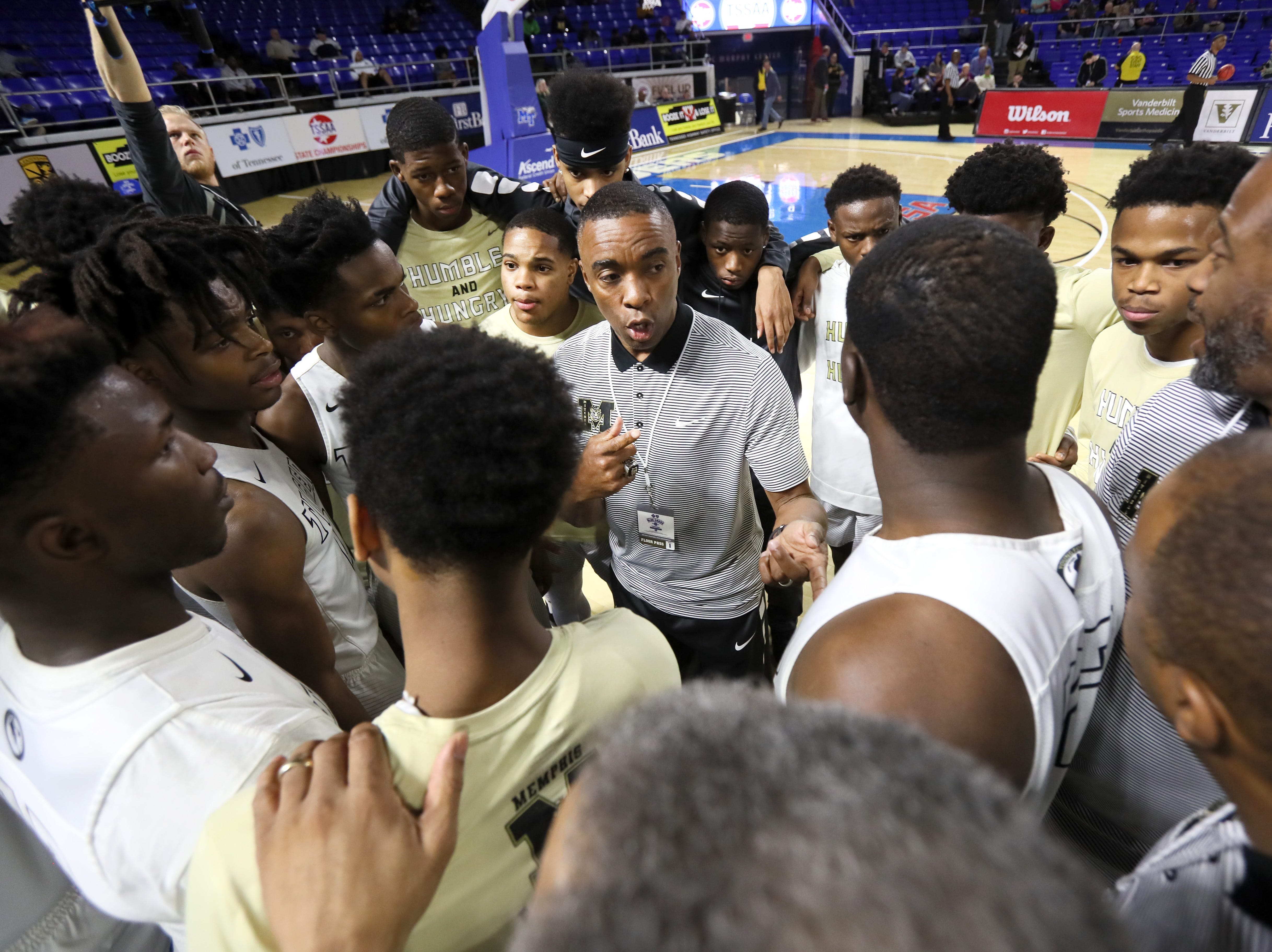 Mitchell Head Coach Andre Turner talks to his team before their game against Fulton during the TSSAA Division I basketball state tournament in Murfreesboro on Wednesday, March 13, 2019.