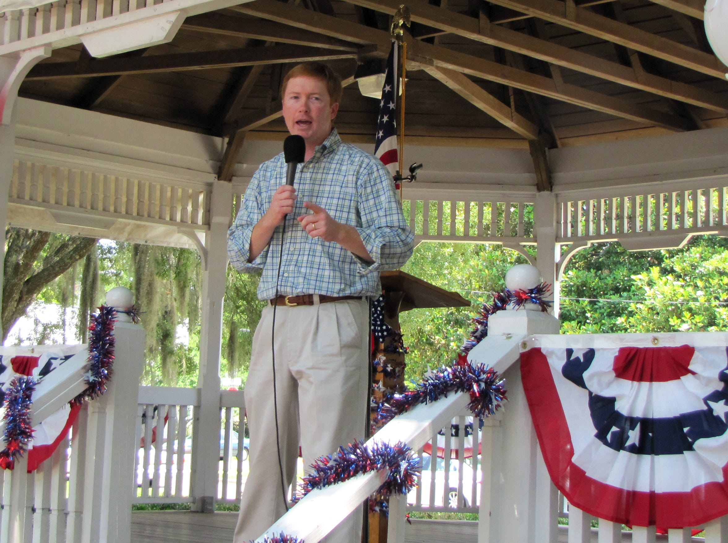 """U.S. Rep. Adam Putnam, the Republican candidate for Florida agriculture commissioner, speaks at a rally Saturday at the gazebo of a park next to the Madison County Courthouse in Madison, Fla. Putnam said Florida Republicans """"have a chance to put a whole new team on the field"""" this year with open races for the U.S. Senate, governor and all three state Cabinet seats."""