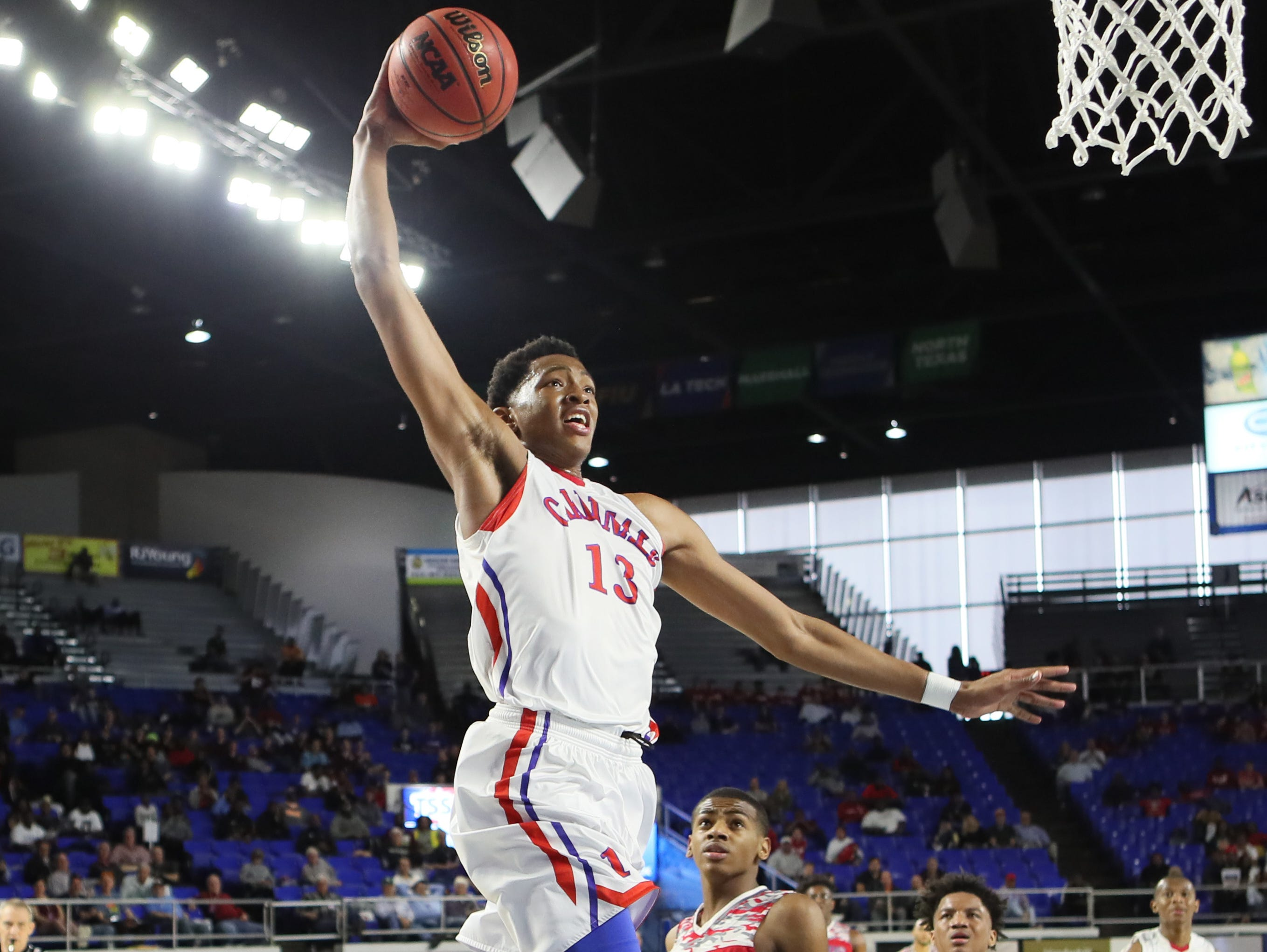 Wooddale's Chandler Lawson dunks the ball against Austin-East during the TSSAA Division I basketball state tournament in Murfreesboro on Wednesday, March 13, 2019.