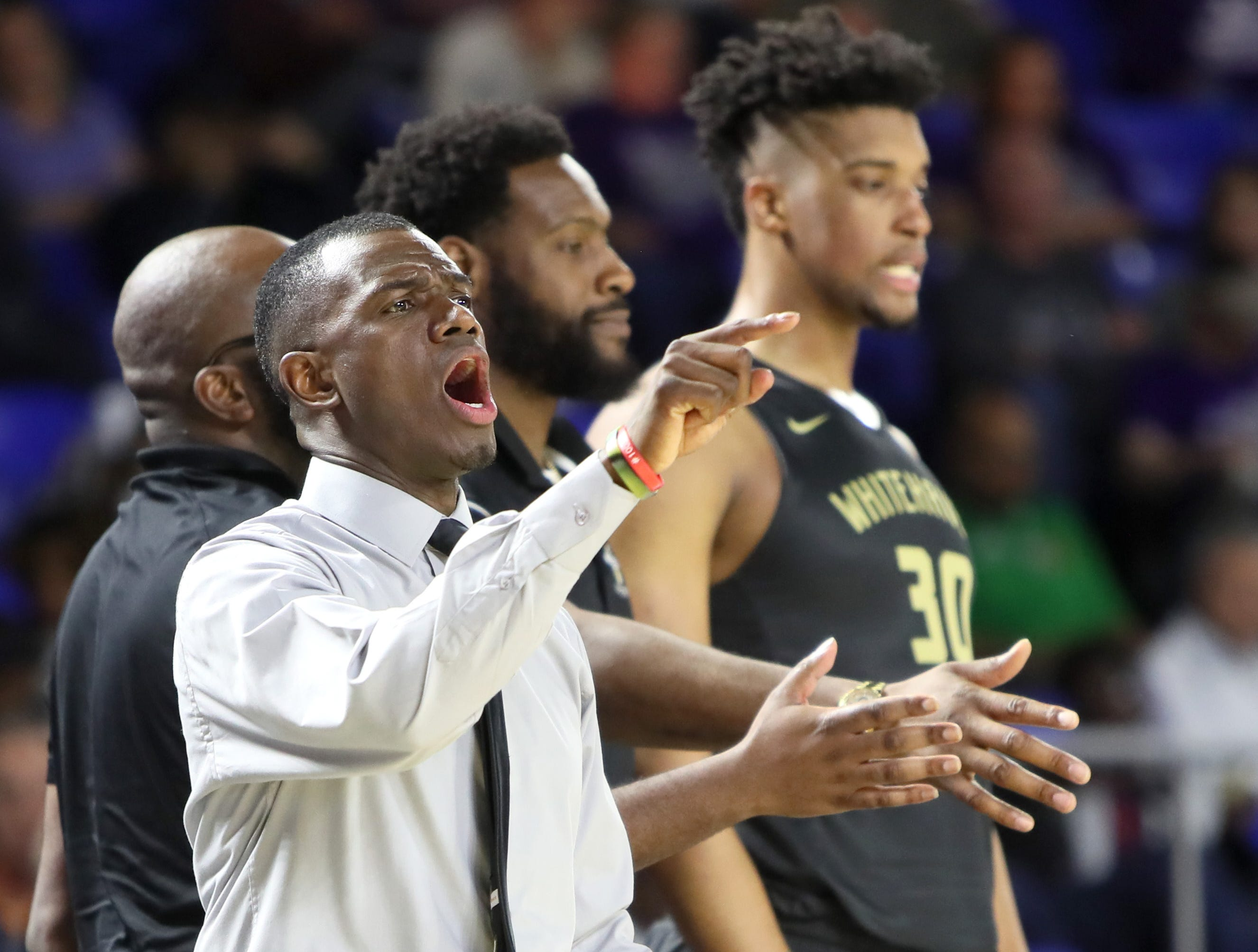 Whitehaven Head Coach Faragi Phillips yells out to his team as they take on Sevier County during the TSSAA Division I basketball state tournament at the Murphy Center in Murfreesboro, Tenn. on Wednesday, March 13, 2019.