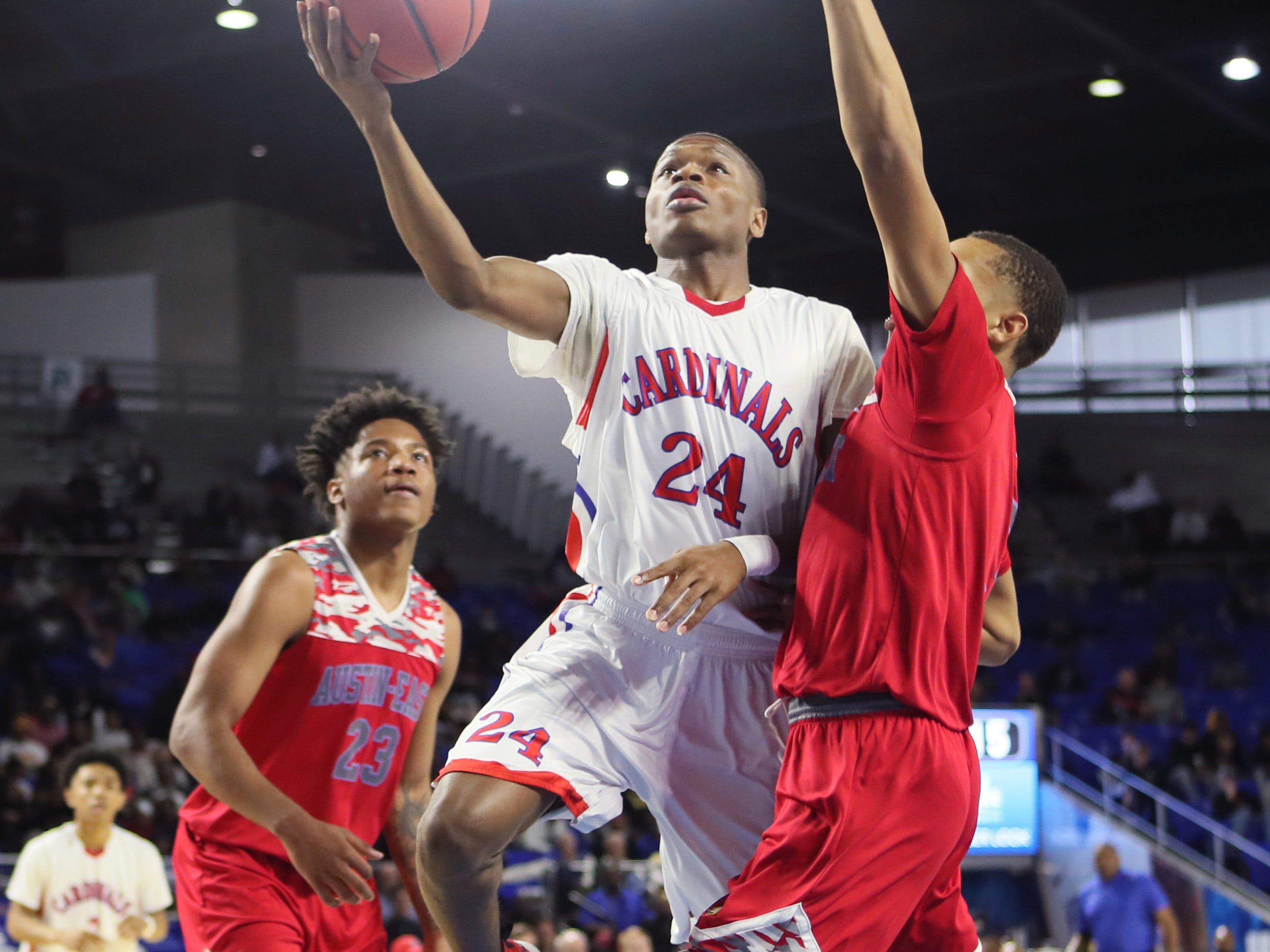 Wooddale's Tekevion Rounds tries to lay the ball up past Austin-East's Jaiohn Foster during the TSSAA Division I basketball state tournament in Murfreesboro on Wednesday, March 13, 2019.