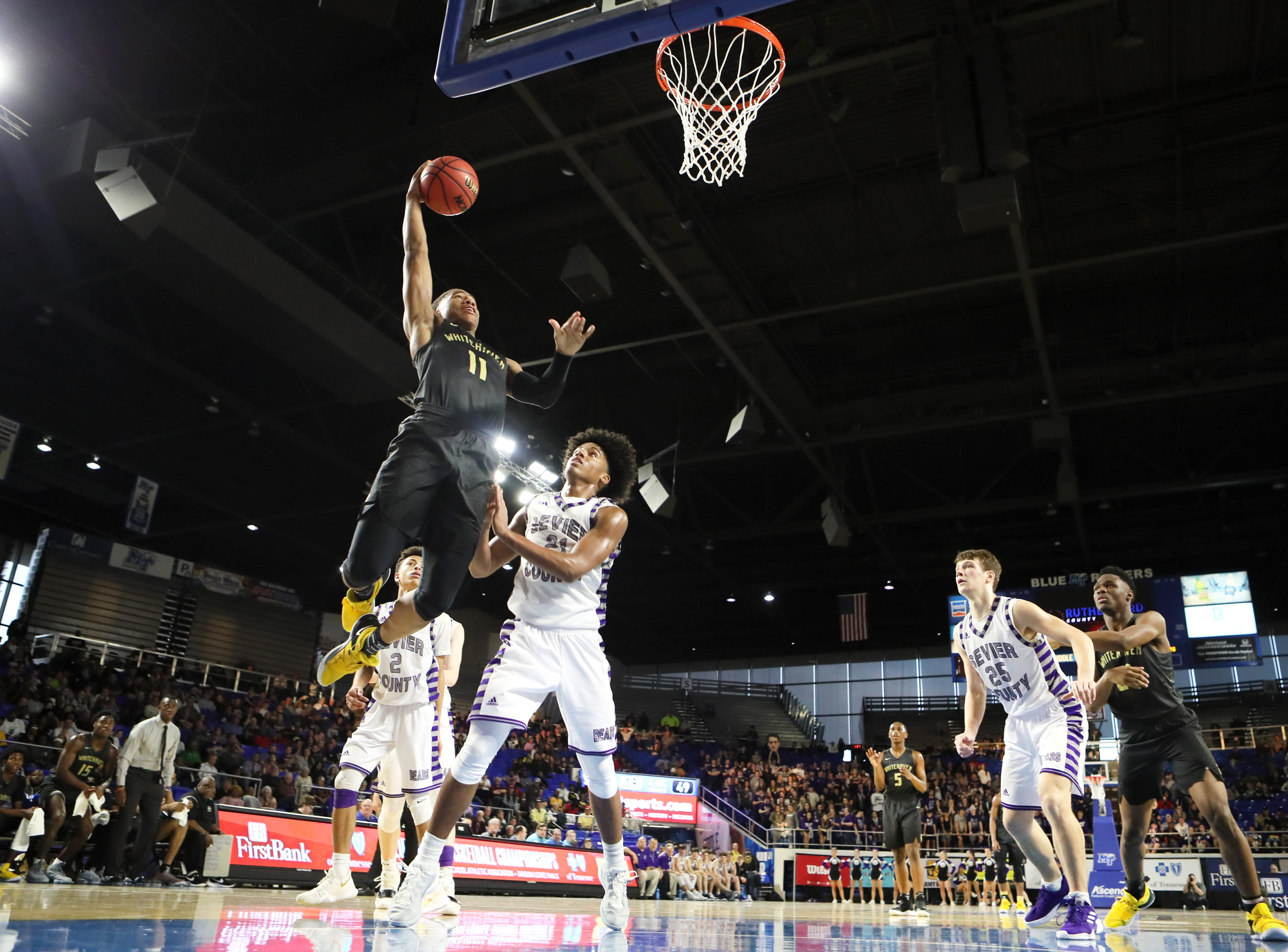 Whitehaven's Matthew Murrell leaps to dunk the ball against Sevier County during the TSSAA Division I basketball state tournament at the Murphy Center in Murfreesboro, Tenn. on Wednesday, March 13, 2019.