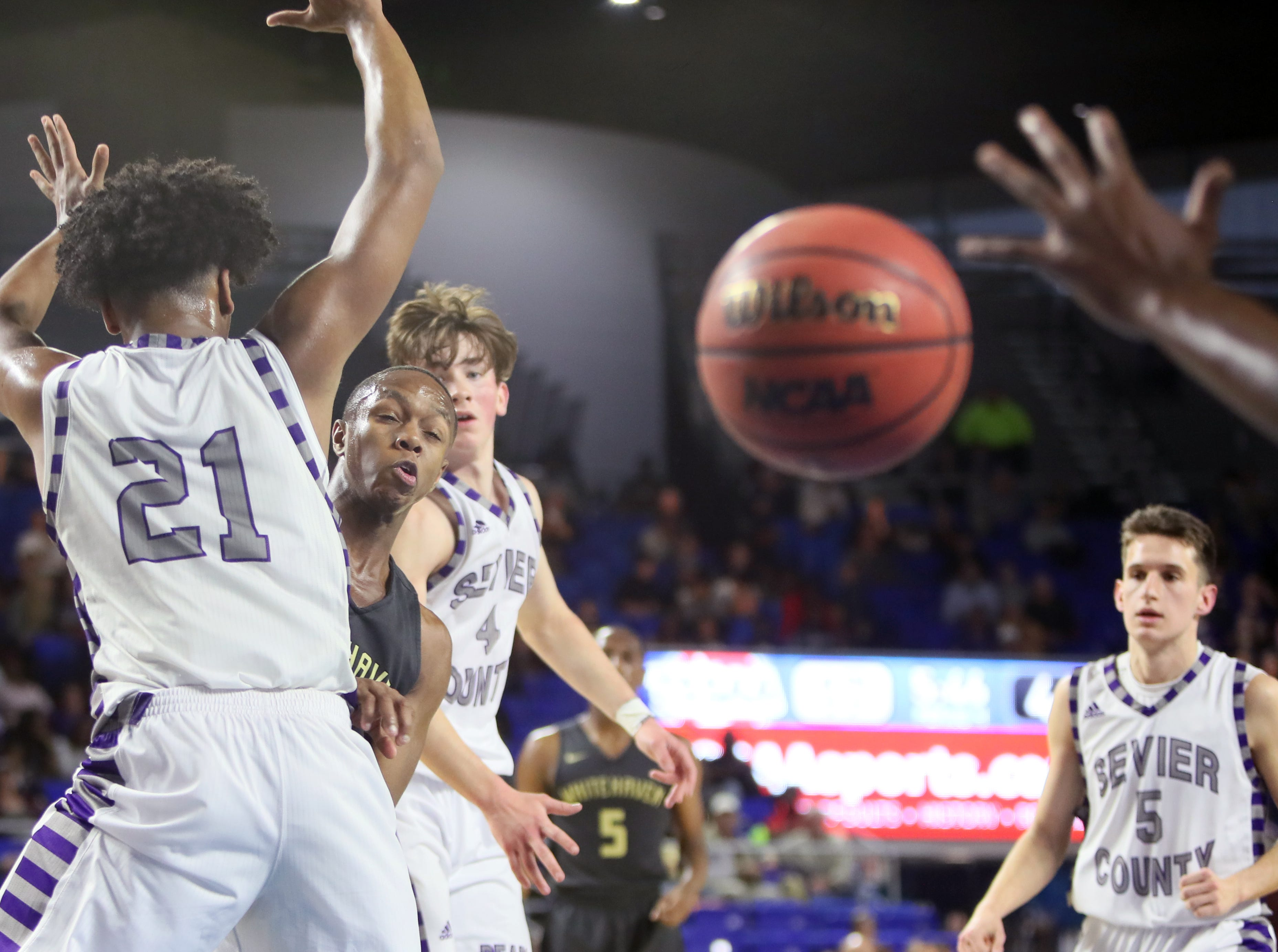 Whitehaven's Antwarn Smith watches as his pass hits a teammate's hand as they take on Sevier County during the TSSAA Division I basketball state tournament at the Murphy Center in Murfreesboro, Tenn. on Wednesday, March 13, 2019.