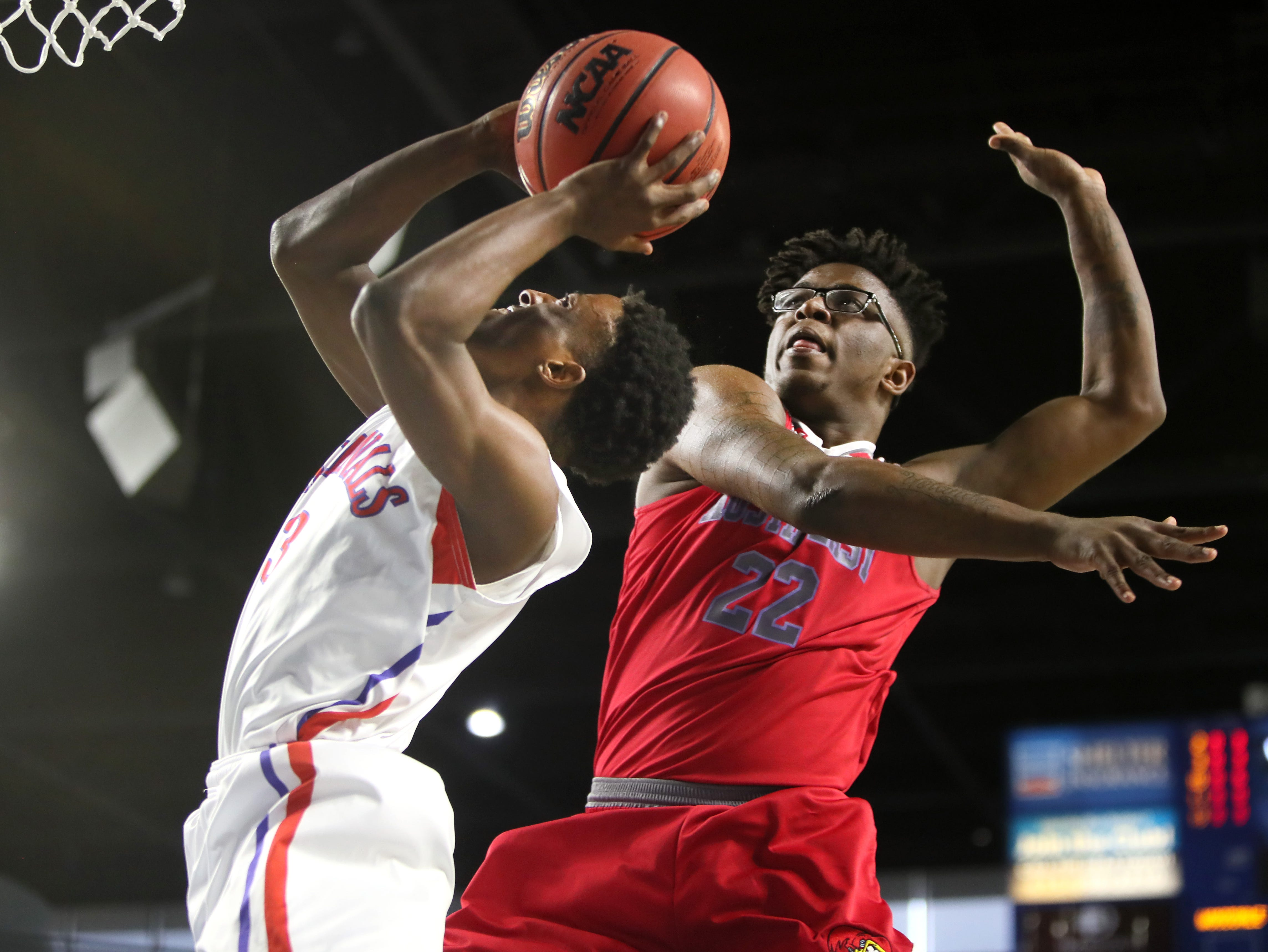 Wooddale's Alvin Miles shoots the ball over Austin-East's Dereke Upton during the TSSAA Division I basketball state tournament in Murfreesboro on Wednesday, March 13, 2019.