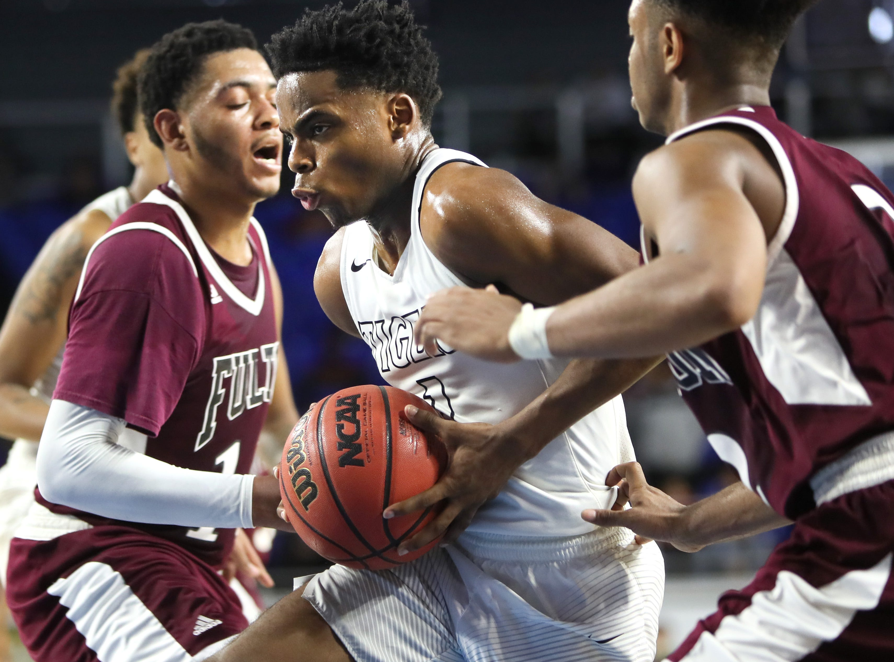 Mitchell's Mikell Rice drives past Fulton's Ron Davis III during the TSSAA Division I basketball state tournament in Murfreesboro on Wednesday, March 13, 2019.