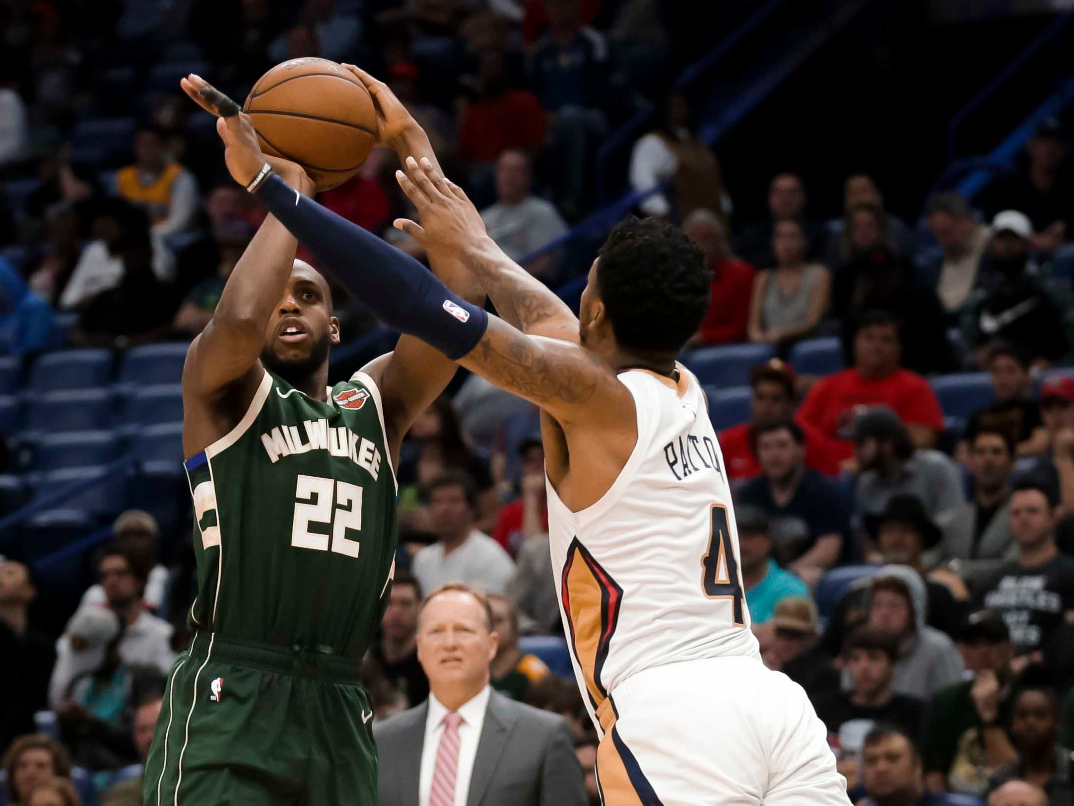 Bucks forward Khris Middleton gets ready to launch a shot over Pelicans guard Elfrid Payton during the second half.