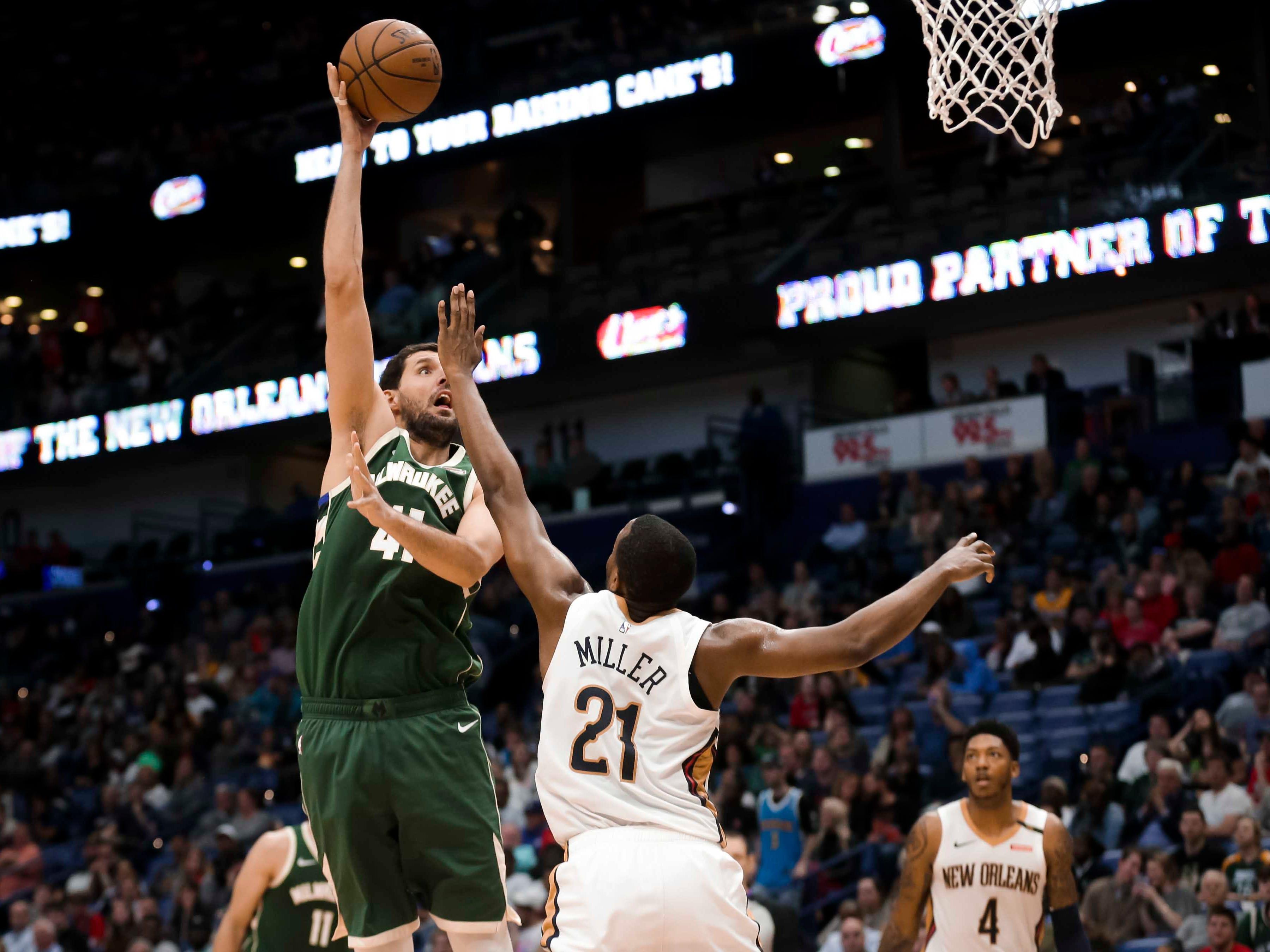Bucks forward Nikola Mirotic puts up a hook shot over Pelicans forward Darius Miller during the second half.