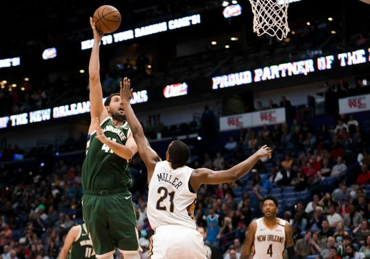 Bucks forward Nikola Mirotic puts up a hook shot over Pelicans forward Darius Miller on March 12.