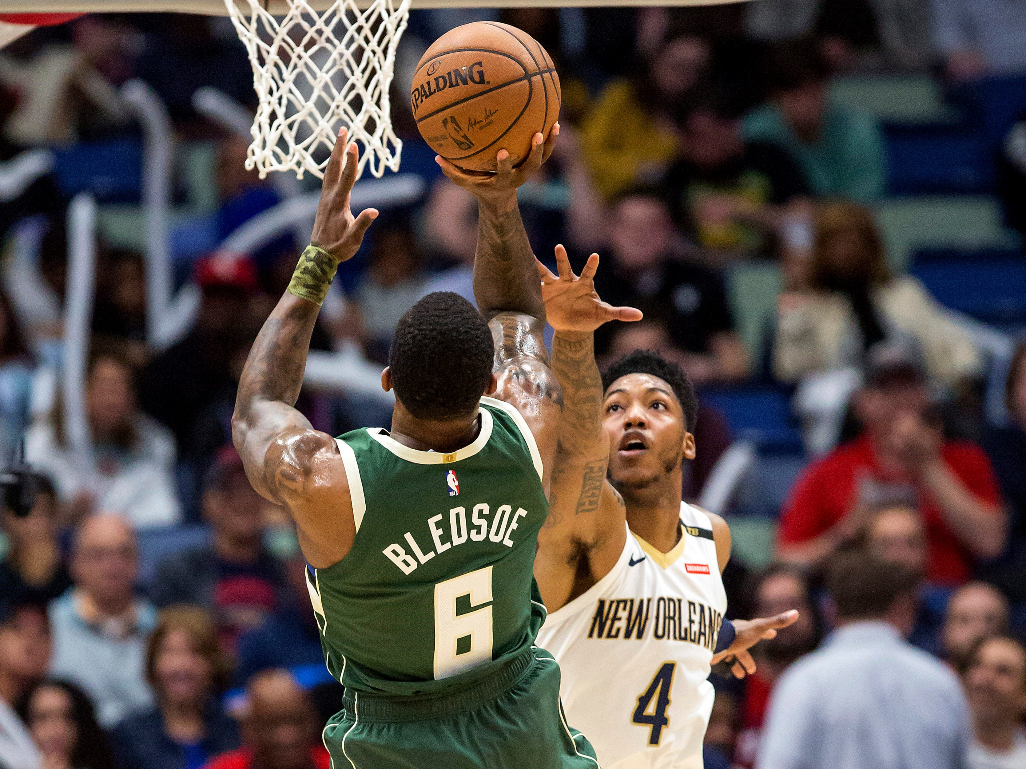 Bucks guard Eric Bledsoe puts up a shot over Pelicans guard Elfrid Payton during the first half Tuesday.