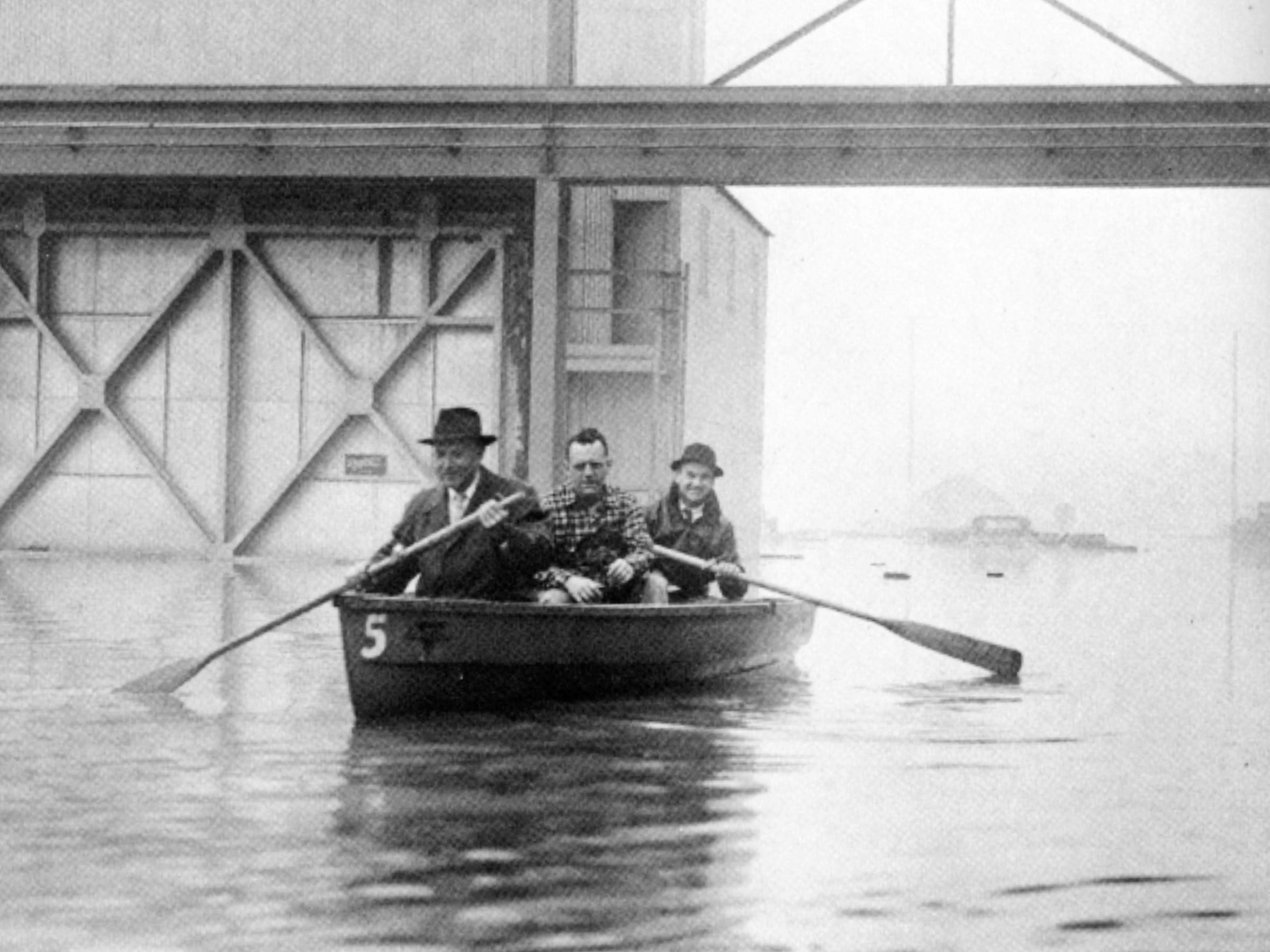 Workers at Falk Corp. are rescued after the Menomonee River overflowed into the company's plant at 3001 W. Canal St. on March 30, 1960.