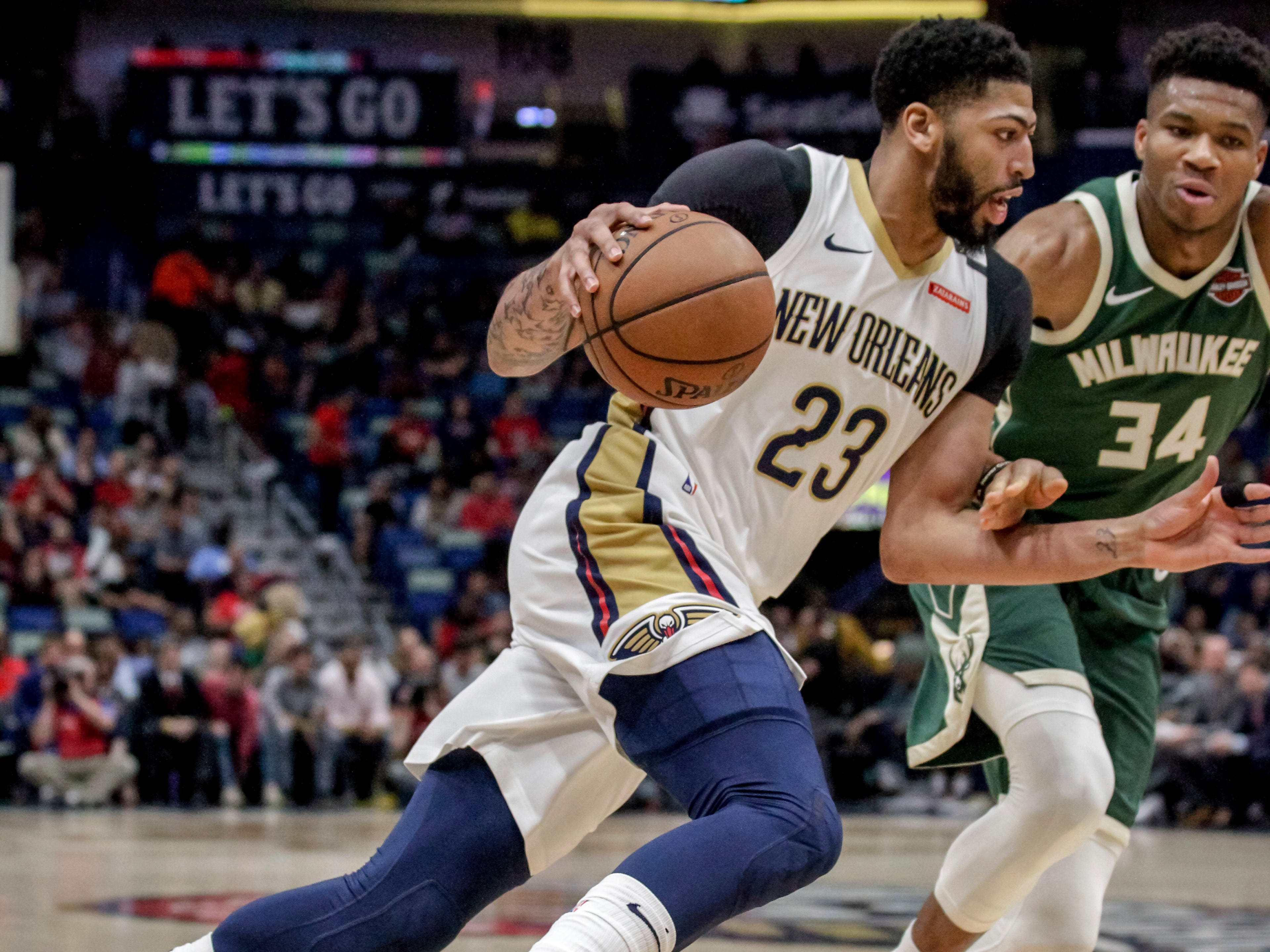 In a matchup of all-stars, Pelicans forward Anthony Davis drives against Bucks forward Giannis Antetokounmpo during the first half.