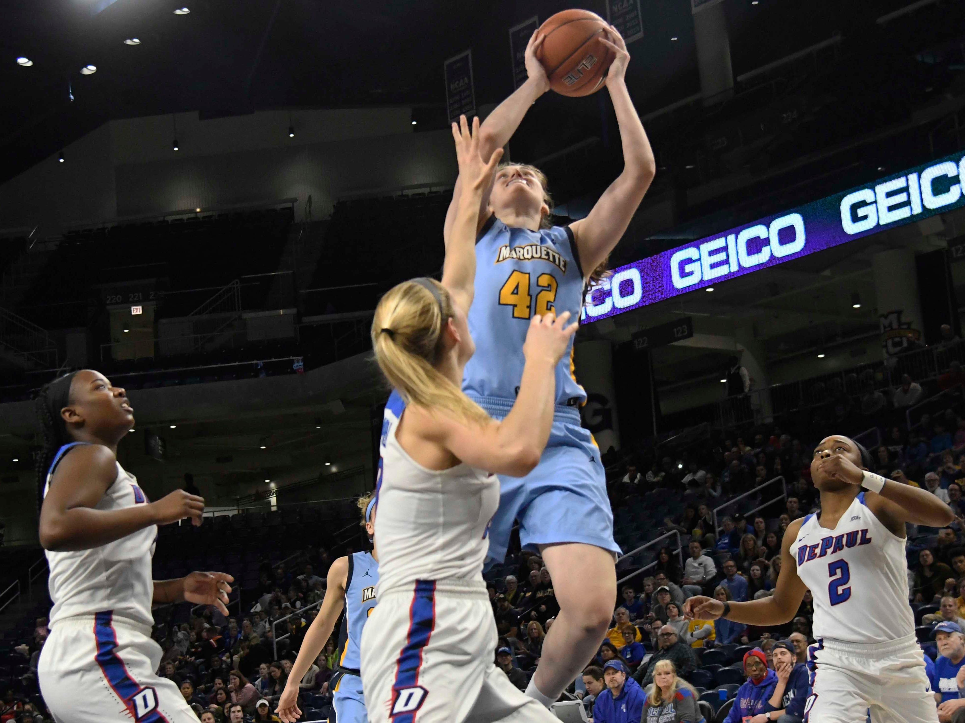 Golden Eagles guard Lauren Van Kleunen shoots over DePaul guard Kelly Campbell during the first half.