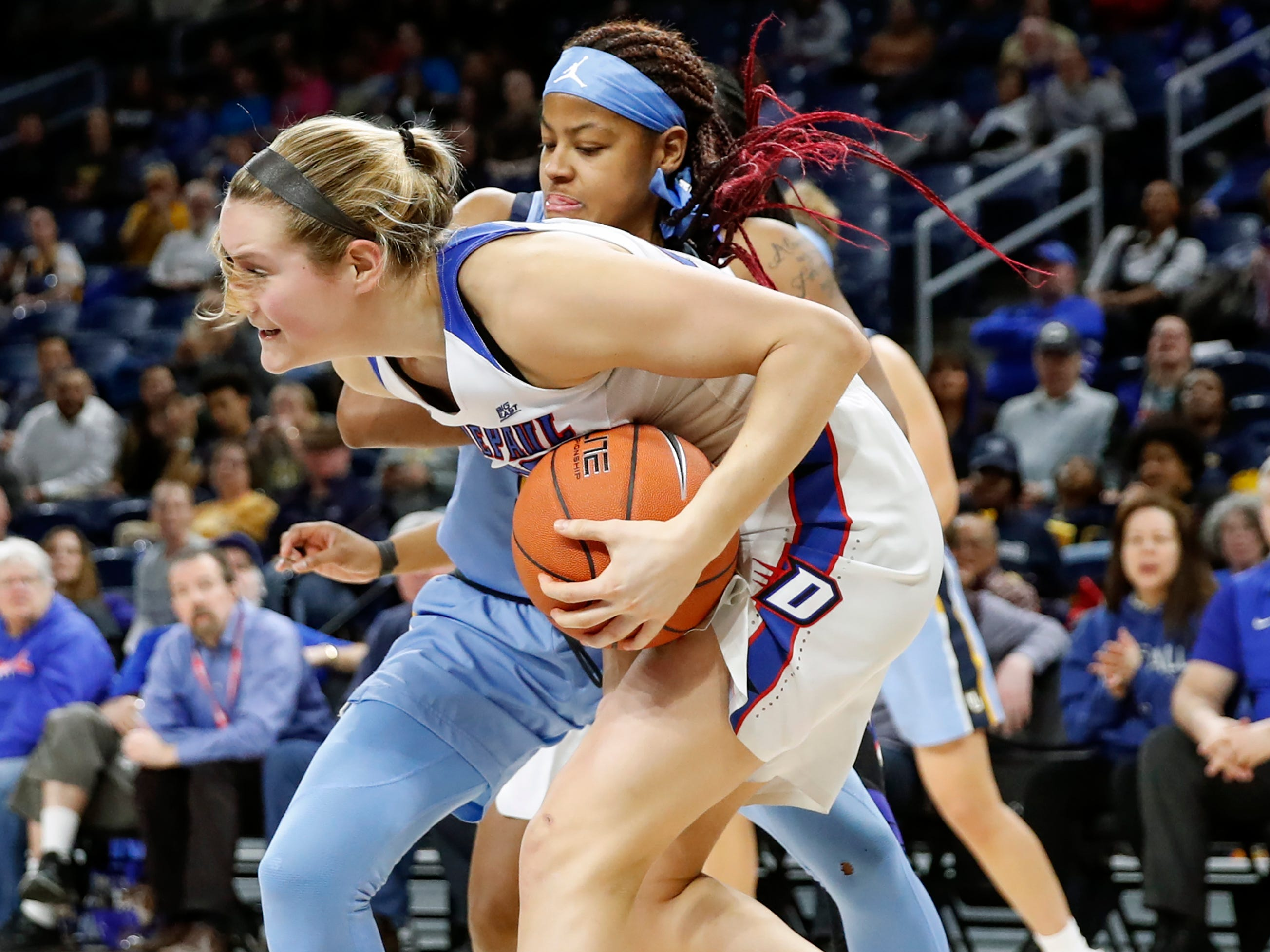 DePaul guard Kelly Campbell steals the ball from Marquette guard Danielle King during the first half.