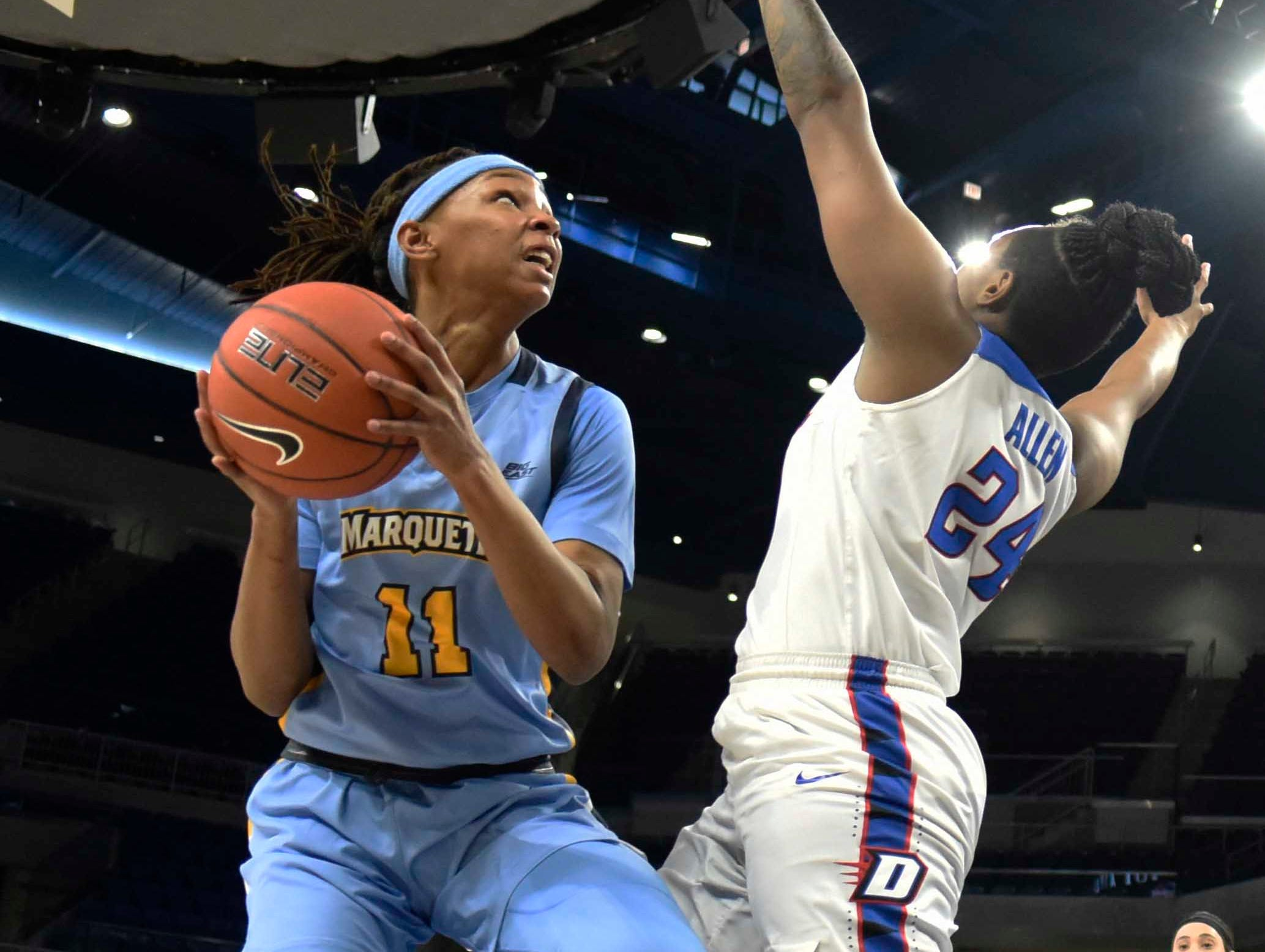 Marquette guard Allazia Blockton looks to shoot as she's defended by DePaul Blue guard Tanita Allen during the first half.