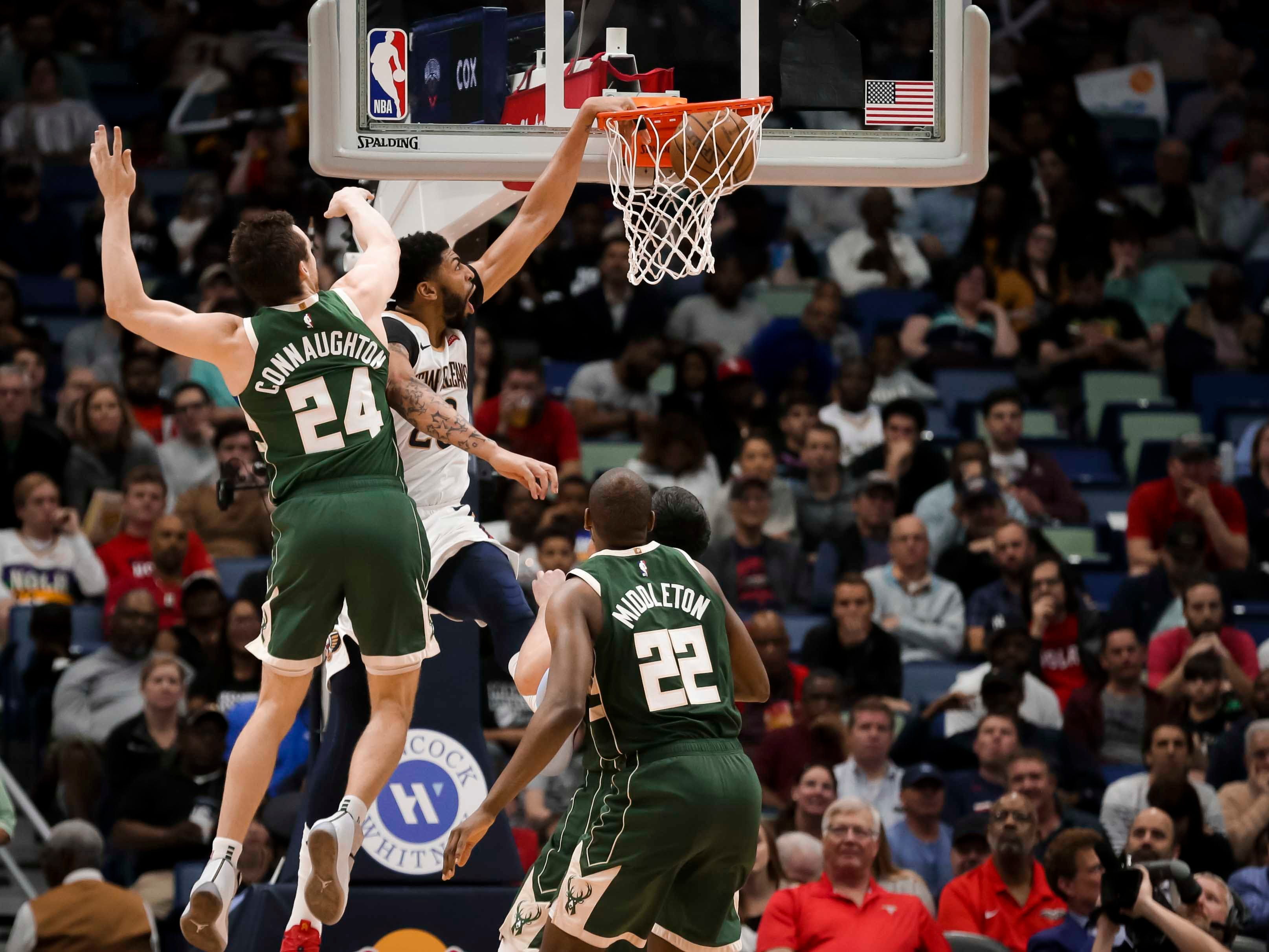 Pelicans forward Anthony Davis powers home a dunk against Bucks guard Pat Connaughton off an alley-oop pass during the second half.