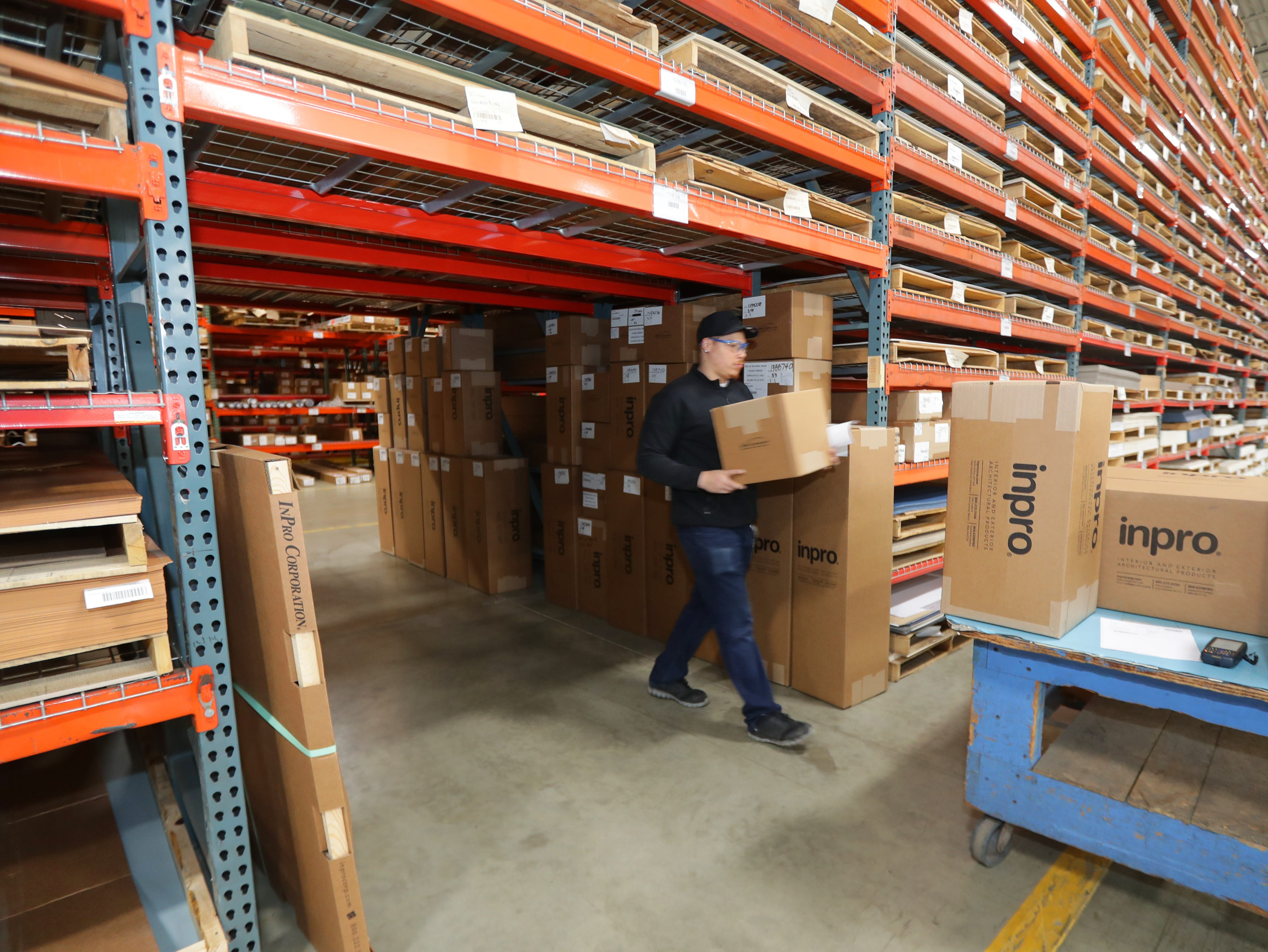 Anthony Burt, an Inpro Corp. UPS shipper, pulls kick plates for doors to be shipped in the distribution area at Inpro in Muskego.
