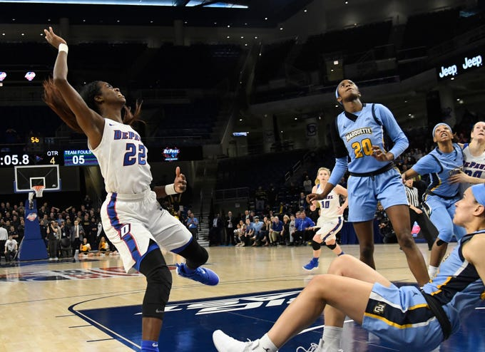 DePaul forward Chante Stonewall watches her game tying shot go in against the Marquette with 5.4 seconds remaining in the second half. Stonewall was fouled on the play and made the free throw to put the Blue Demons ahead.
