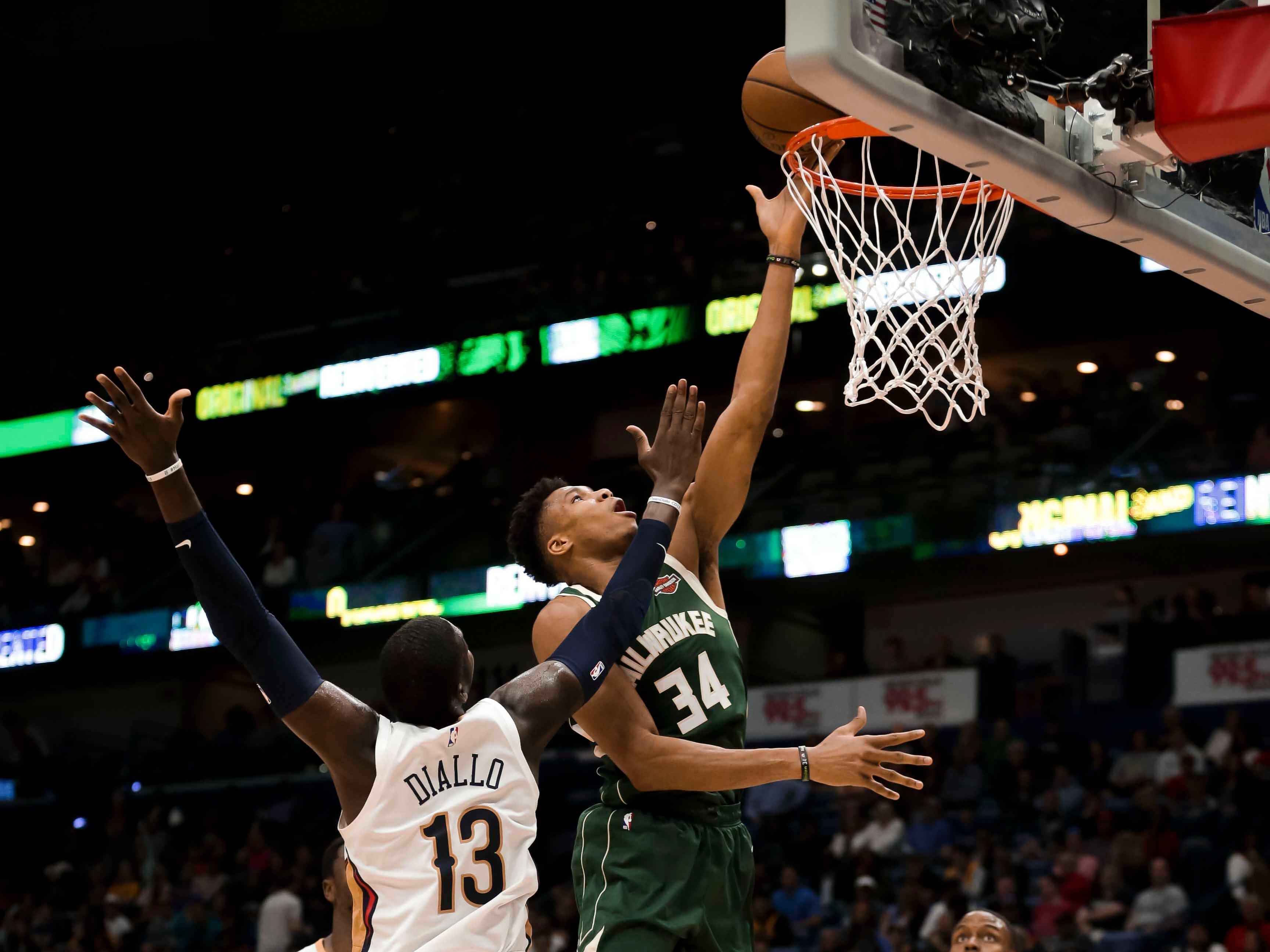 Bucks forward Giannis Antetokounmpo scores against Pelicans forward Cheick Diallo during the second half.