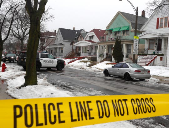 Milwaukee police block off a homicide scene on the city's south side in February.