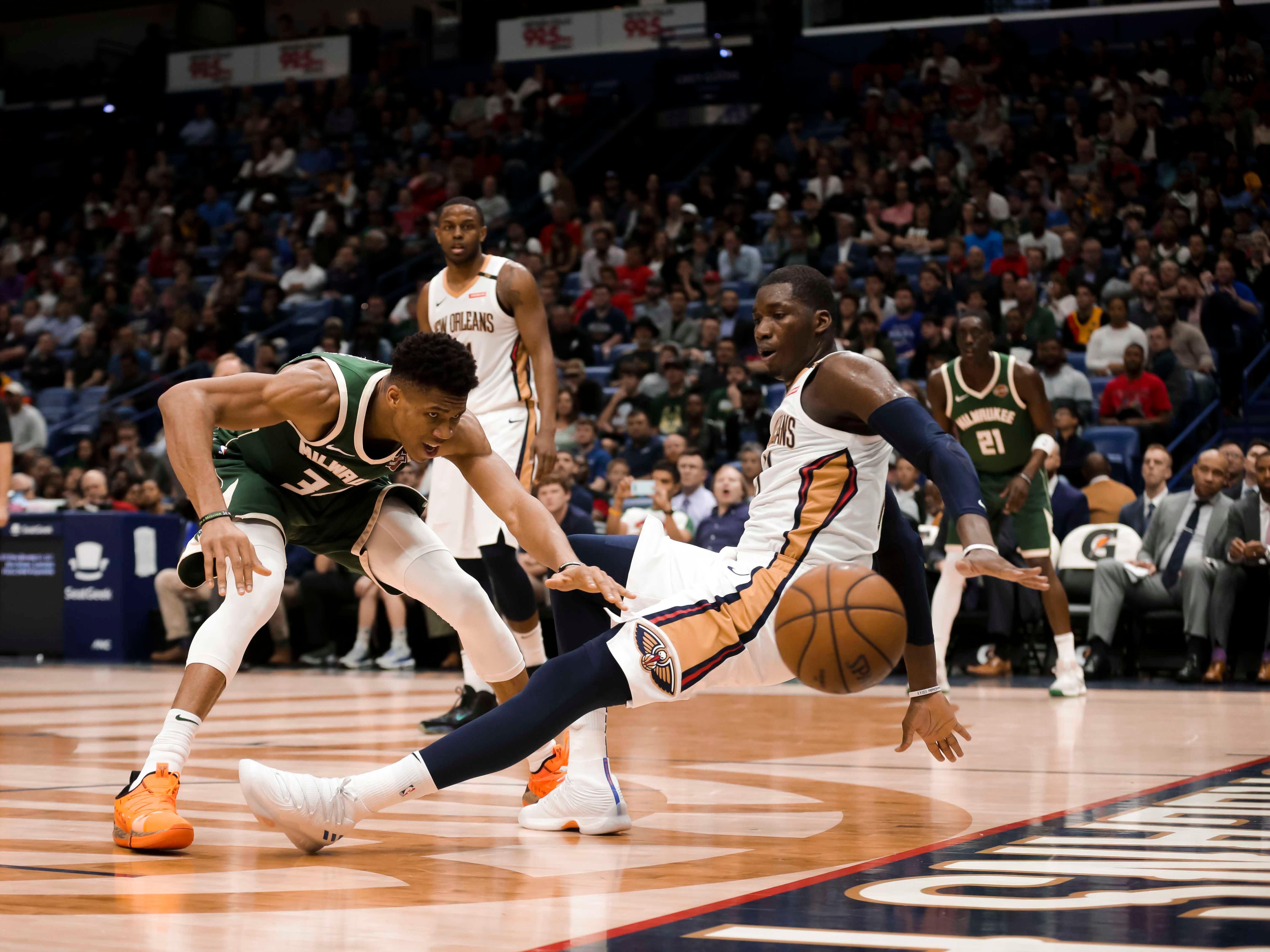 Bucks forward Giannis Antetokounmpo draws a foul on a collision with Pelicans forward Cheick Diallo during the second half.