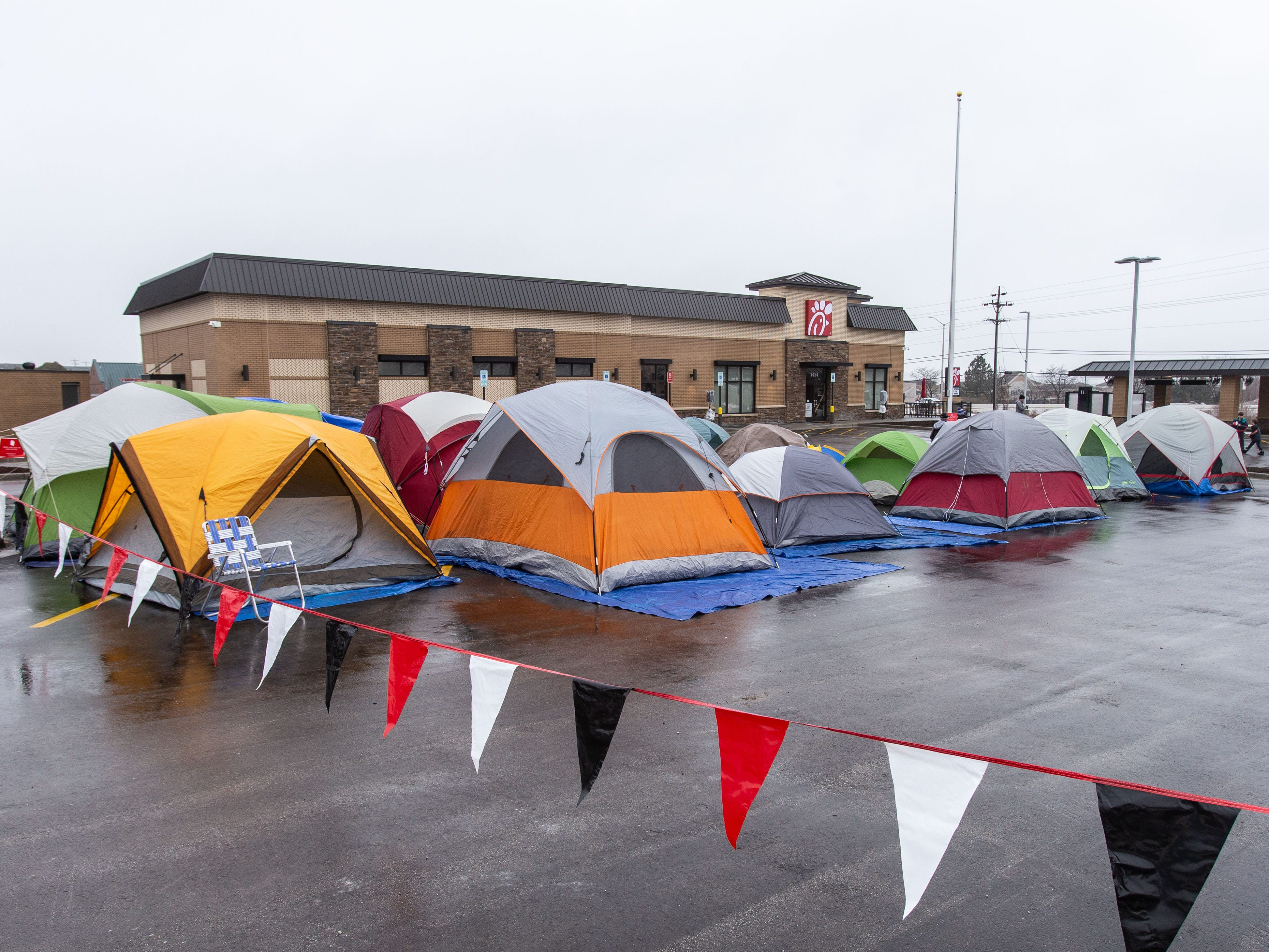 Campers fill the parking lot of Pewaukee's new Chick-fil-A location at 1454 Capitol Drive on Wednesday, March 13, ahead of Thursday's grand opening. Chick-fil-A is holding The First 100 Camp Out contest which offers a year's worth of free Chick-fil-A to the first 100 participants.