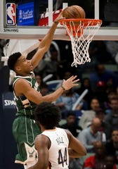 Mar 12, 2019; New Orleans, LA, USA; Milwaukee Bucks forward Giannis Antetokounmpo (34) dunks over New Orleans Pelicans forward Solomon Hill (44) during the second quarter at the Smoothie King Center. Mandatory Credit: Derick E. Hingle-USA TODAY Sports