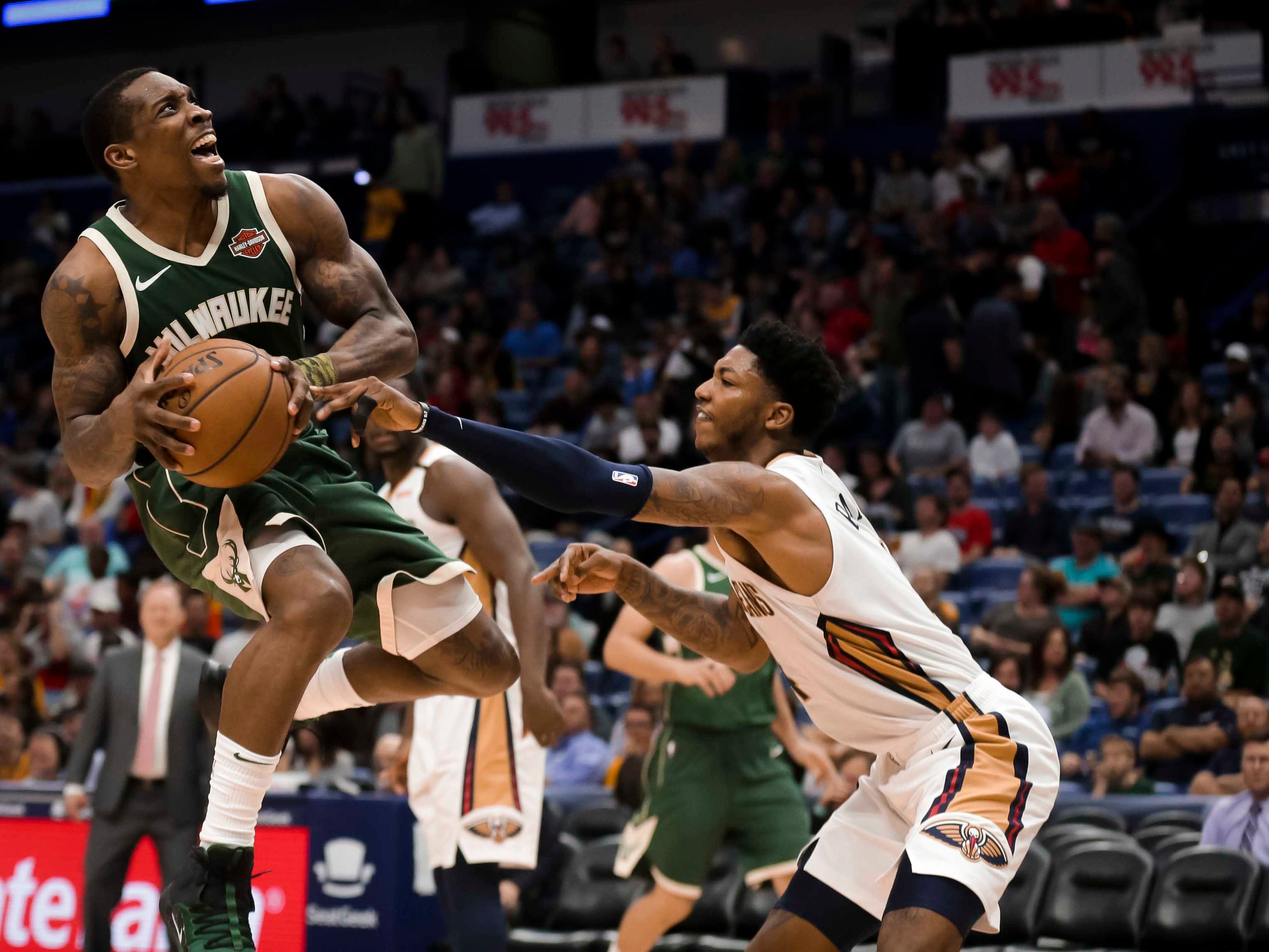 Bucks guard Eric Bledsoe goes up for a shot after driving to the rack against Pelicans guard Elfrid Payton during the second half Tuesday night at the Smoothie King Center in New Orleans.