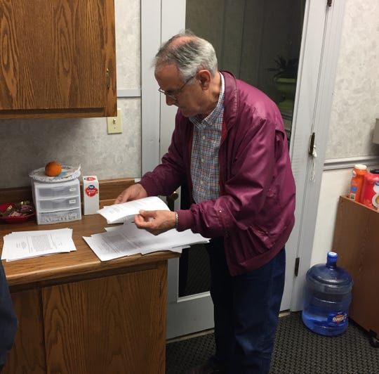 Baxter County Election Commissioner Rick Peglar hand-counts ballots Tuesday night for the Norfork School District's proposed millage increase. Tuesday's election was the first for Peglar as a member of the Election Commission.