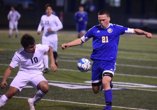 Mountain Home's Quentin Fourny (21) controls the ball against Searcy on Tuesday night.