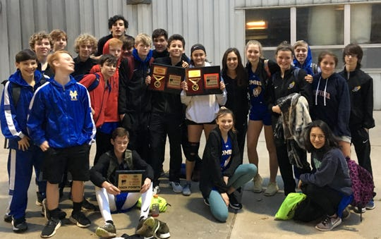The Mountain Home Junior Bombers and Junior Lady Bombers track and field teams pose with their championship trophies after winning the Green Forest track meet on Tuesday night.