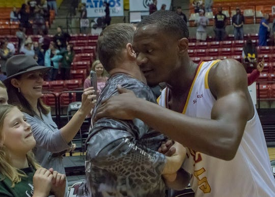 University of Louisiana at Monroe's Daishon Smith (5) shakes hands and hugs a fan after the team's 89-80 win over Appalachian State during the first round Sunbelt playoff game at Fant-Ewing Coliseum in Monroe, La. on March 12. ULM will travel to New Orleans for second round playoff action on Thursday.