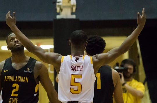 University of Louisiana at Monroe's Daishon Smith (5) pumps up the crowd to create a distraction during Appalachian State's Justin Forrest's (50) free-throw attempts during the first round Sunbelt playoff game at Fant-Ewing Coliseum in Monroe, La. on March 12. ULM would win the game 89-80 to advance to second round playoff action in New Orleans on Thursday.