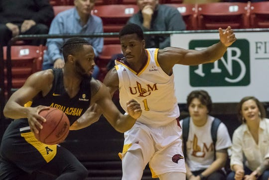 University of Louisiana at Monroe's Travis Munnings (1) plays defense against Appalachian State's Ronshad Shabazz (2) during the first round Sunbelt playoff game at Fant-Ewing Coliseum in Monroe, La. on March 12.