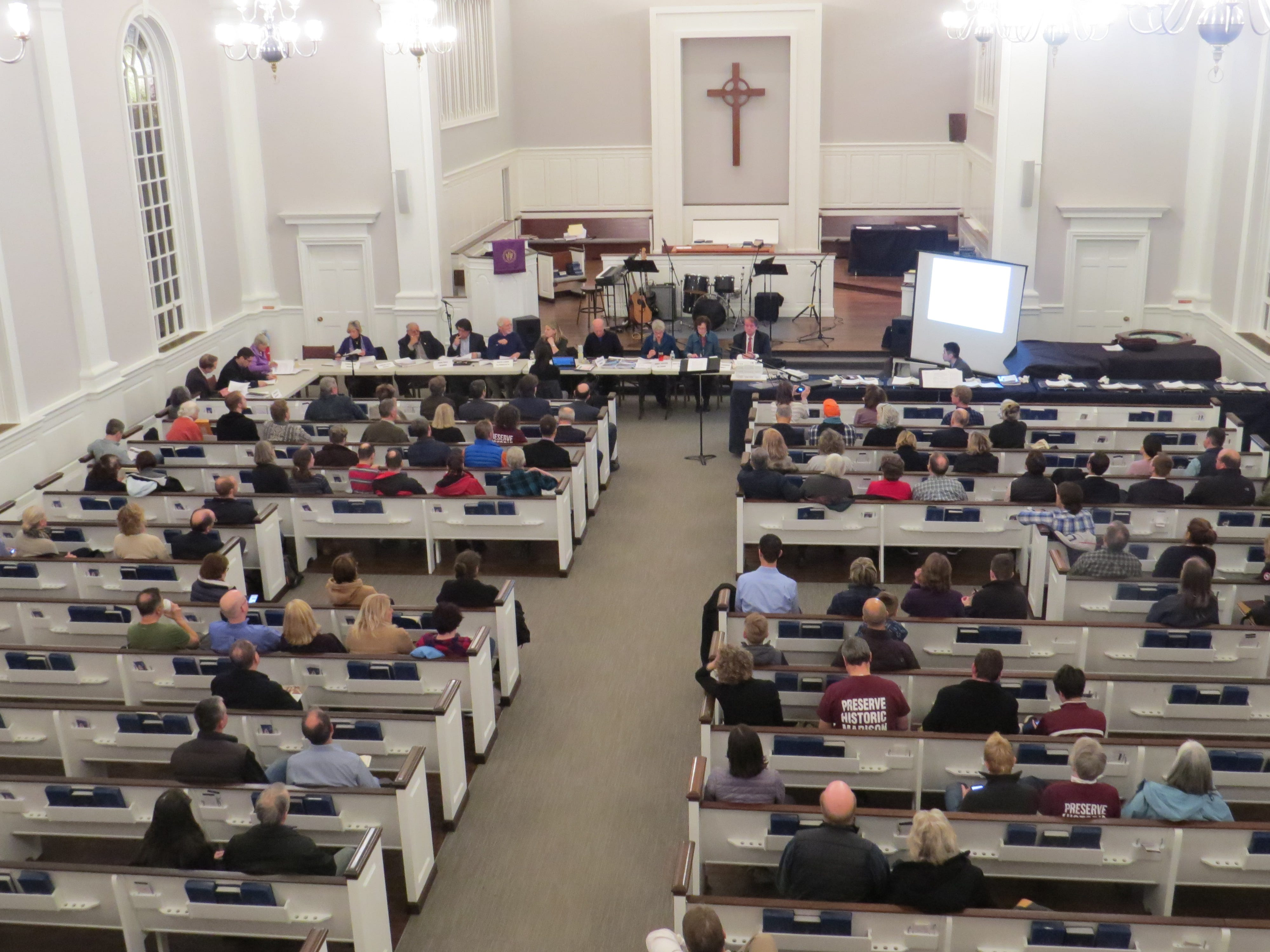 Residents pack the Presbyterian Church of Madison for a meeting of the Madison Historic Preservation Commission meeting March 12, 2019. More than 100 turned out for discussion about the proposed demolition of the historic Madison Theatre, requiring the meeting to be moved across the street from the council chambers at the Hartley-Dodge Memorial.