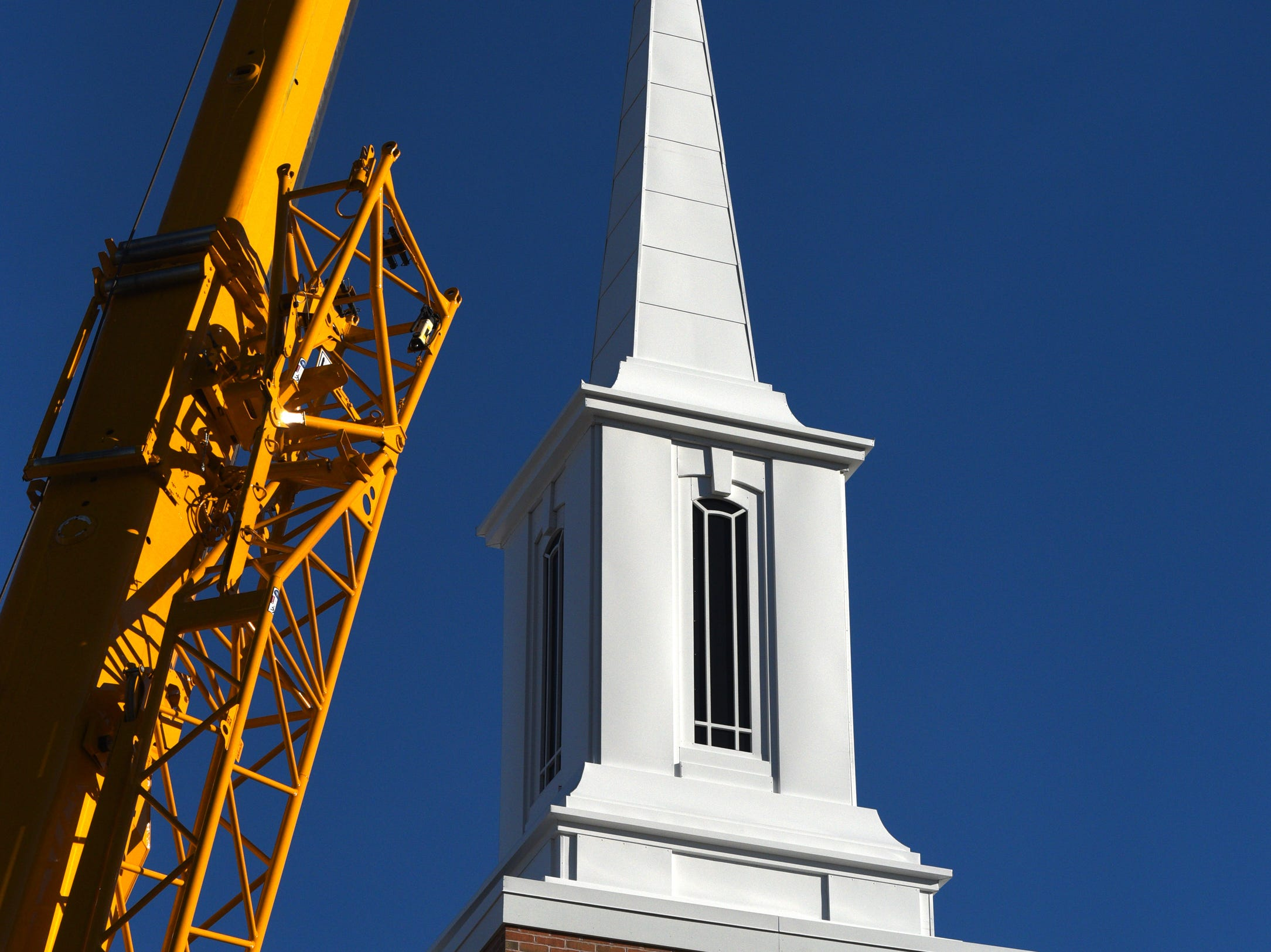 A new steeple sits atop the The Church of Jesus Christ of Later-day Saints in Dover on Wednesday, March 13, 2019.