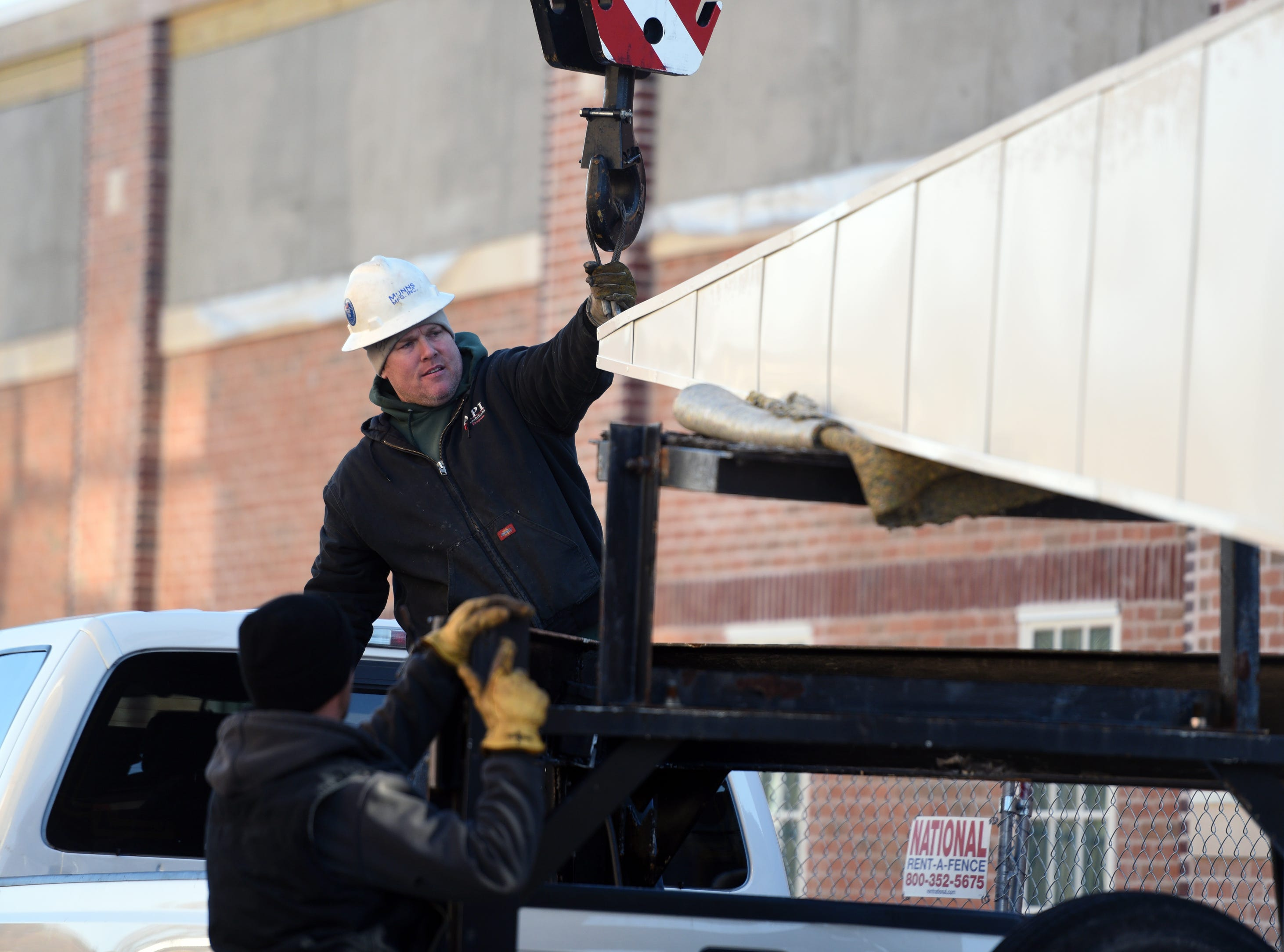 A new steeple is prepared to be raised onto the The Church of Jesus Christ of Later-day Saints in Dover on Wednesday, March 13, 2019.